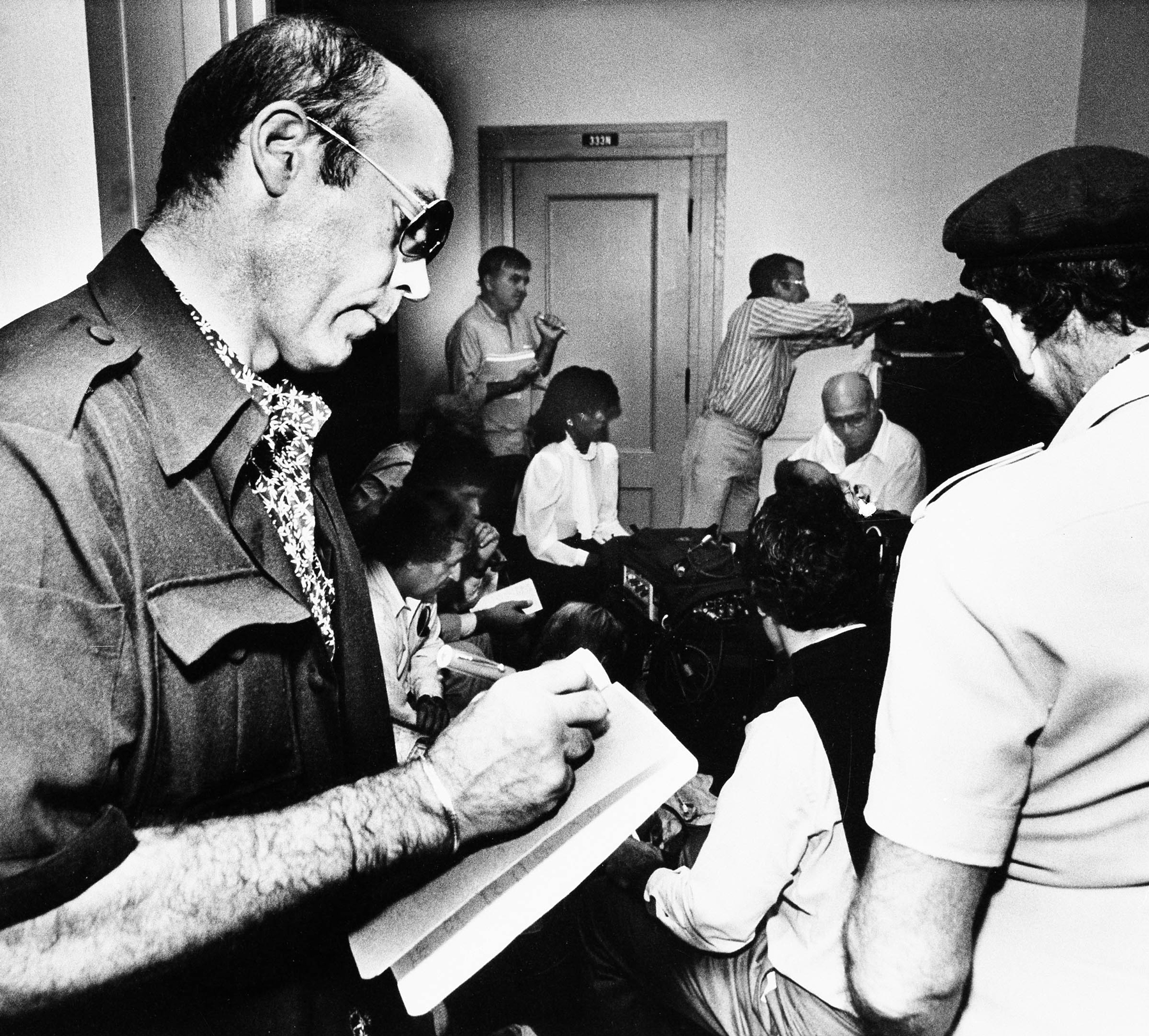 Hunter S. Thompson, Rolling Stone writer and author, checks his notes as he listens to testimony during Pulitzer trial in West Palm Beach, Fla.. November 4, 1982. Reporters from three continents have converged on the courthouse in Palm Beach to cover the trial. (AP Photo/Ray Fairall)