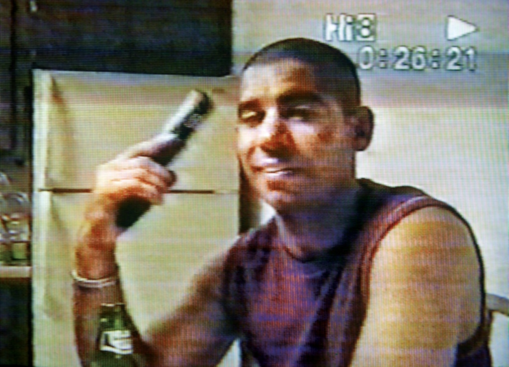 This photo taken from video and released by Dan Roselle shows Ricky Rodriguez, a former member of The Family International, holding a handgun in this video filmed in early January, 2005. Rodriguez, groomed to inherit leadership of The Family, filmed this video before stabbing to death a prominent former member in Arizona, then driving to Blythe, Calif., and shooting himself in the head.