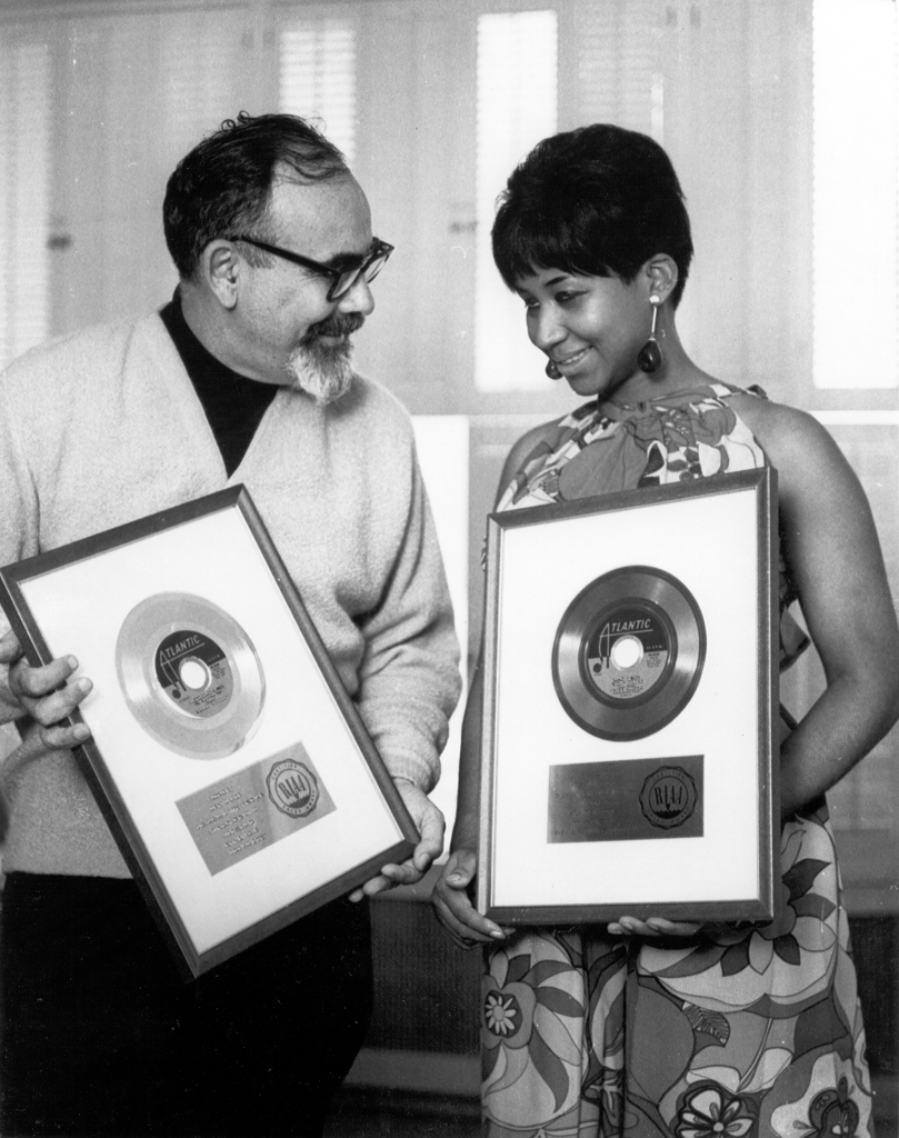 NEW YORK - 1967:  Singer Aretha Franklin and producer Jerry Wexler receive their gold records for their hit single 'I Never Loved A Man (The Way I Love You) in 1967 in New York city, New York. (Photo by Michael Ochs Archives/Getty Images)