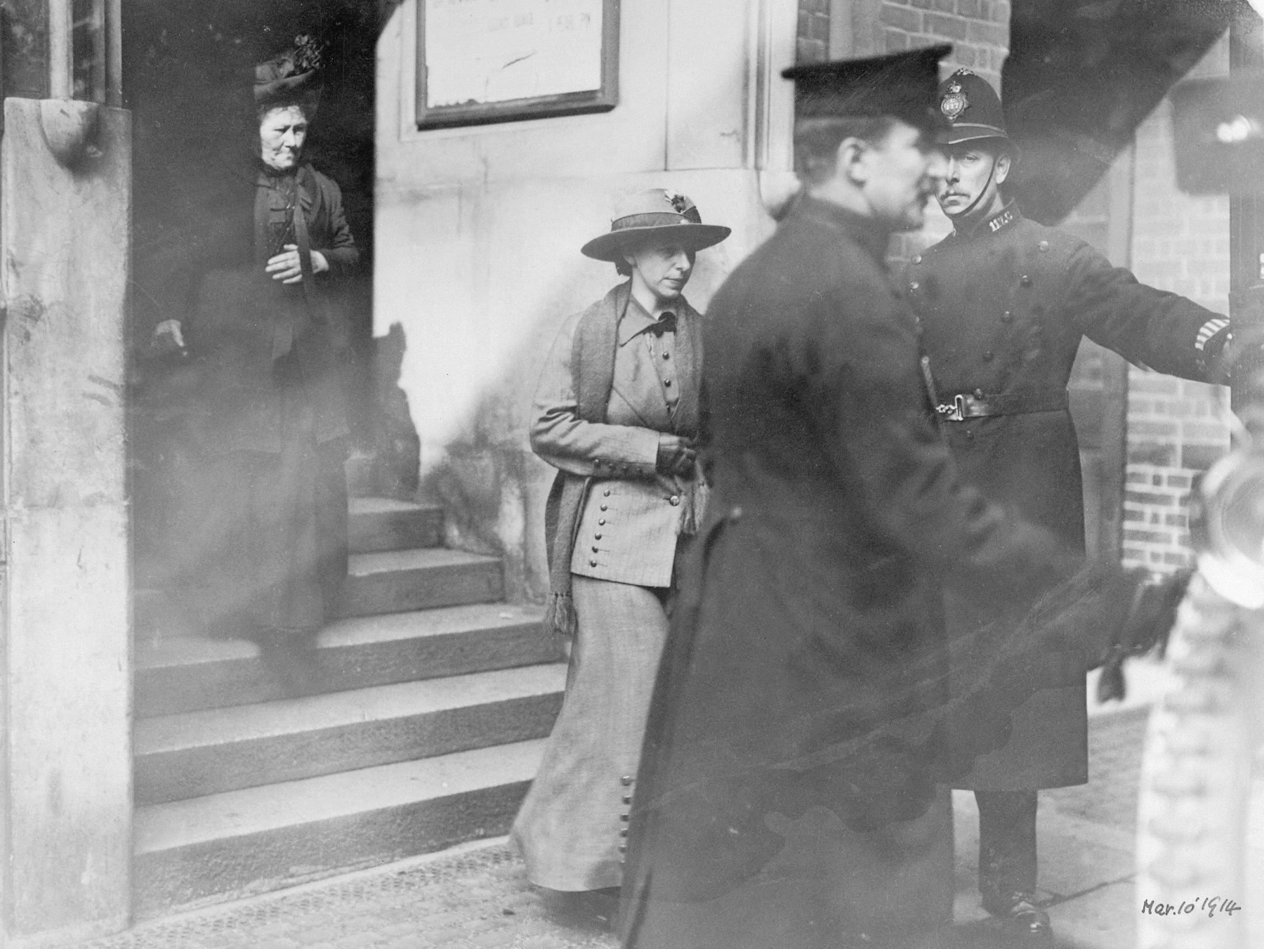 'Slasher' Mary Richardson leaving court, 1914. Richardson (centre), had attacked the Rokeby Venus at the National Gallery in London on 4th March 1914, slashing it seven times with a meat cleaver. This was in protest at the government's failure to give women the vote. Attacks on works of art prompted the closure of many of the country's art galleries and museums to women, and sometimes to the public completely. At places of historical interest the rule of 'No muffs, wrist-bags, or sticks' was widespread. Later, in May 1914, the Royal Academy and the Tate Gallery closed to the public. The British Museum was more flexible, opening to women accompanied by men who would accept responsibility for them. Unaccompanied women were only allowed in if they had a letter of recommendation from a gentleman who would vouch for their good conduct and take responsibility for their actions. (Photo by Museum of London/Heritage Images/Getty Images)