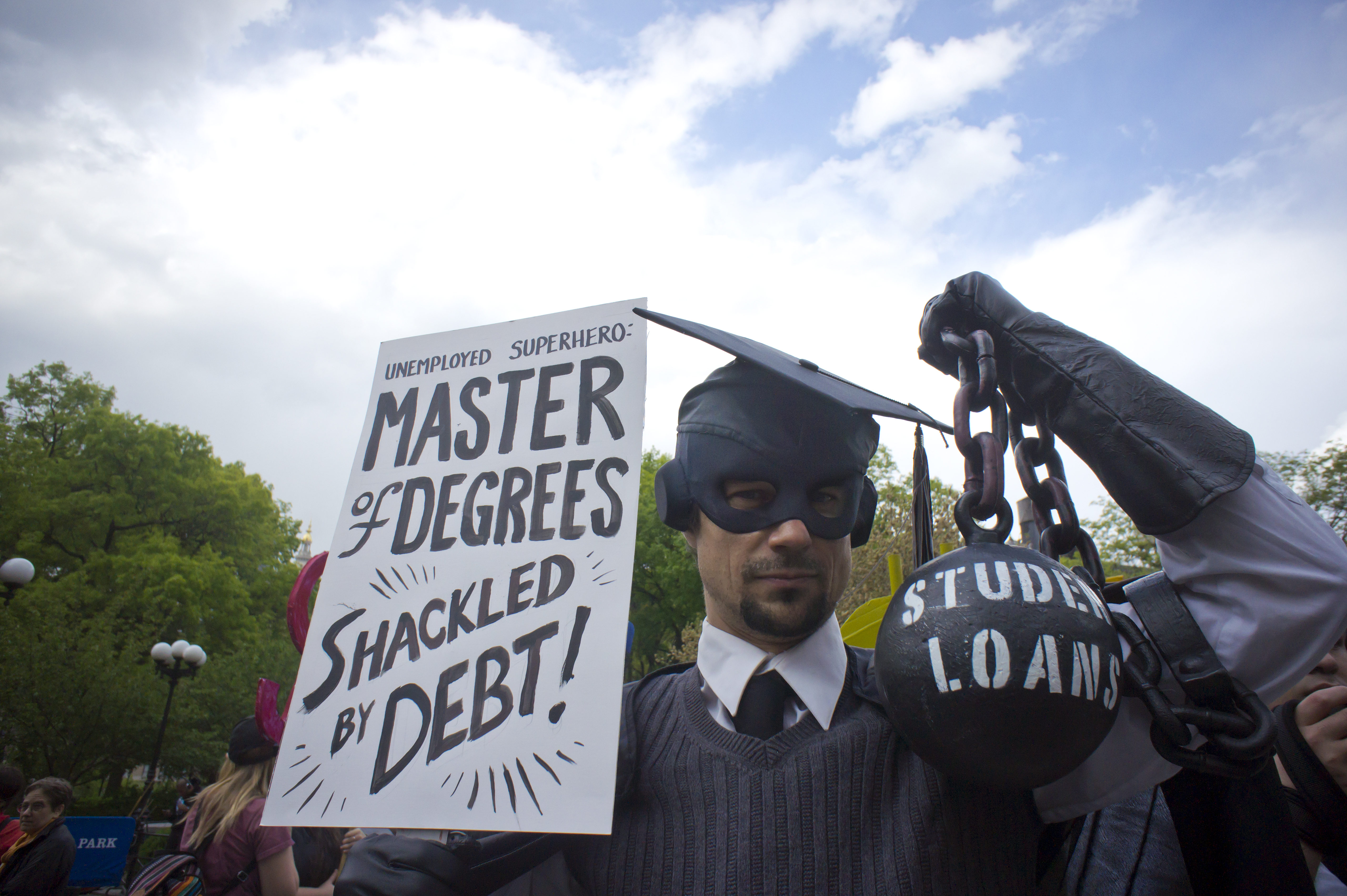 Gan Golan, in his 'Master of Degrees costume, joins Occupy Wall Street protesters, students and supporters at a rally in Union Square Park in New York on Wednesday, April 25, 2012.