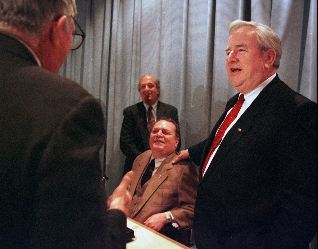 The Rev. Jerry Falwell, right, the Lynchburg,Va., televangelist, puts his hand on the shoulder of Larry Flynt, publisher of Hustler magazine, as they greet Robert M. O'Neil, left, director of the Thomas Jefferson Center for the Protection of Free Expression, prior to a forum at the University of Virginia law school in Charlottesville, Va., Saturday, Nov.1,1997. They discussed their roles in a landmark First Amendment case where Falwell sued Flynt for a 1983 Hustler magazine ad parody. Man in background is unidentified.