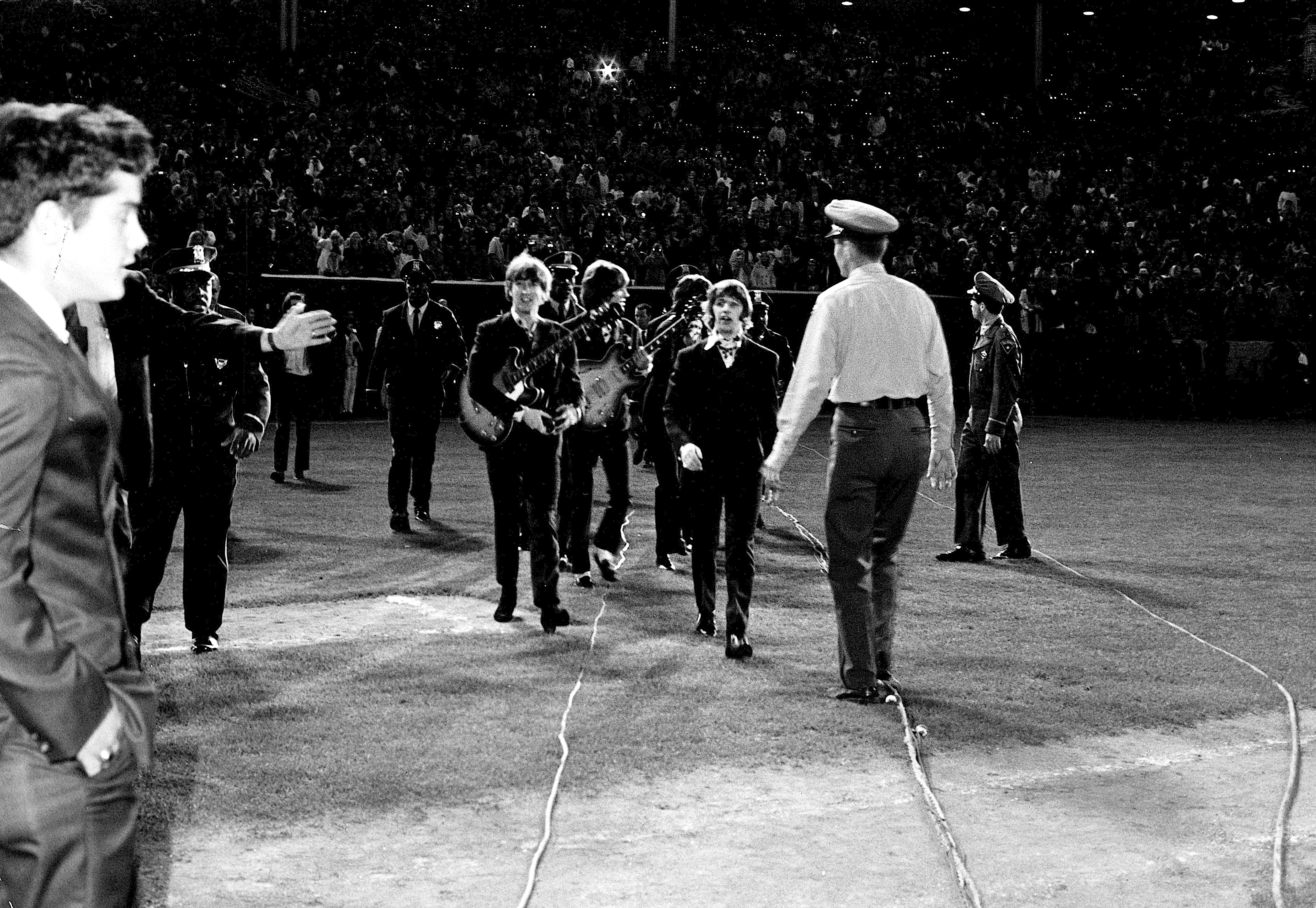 e2430b8e61a The Beatles walking to the stage for the last show of their final tour at  Candlestick