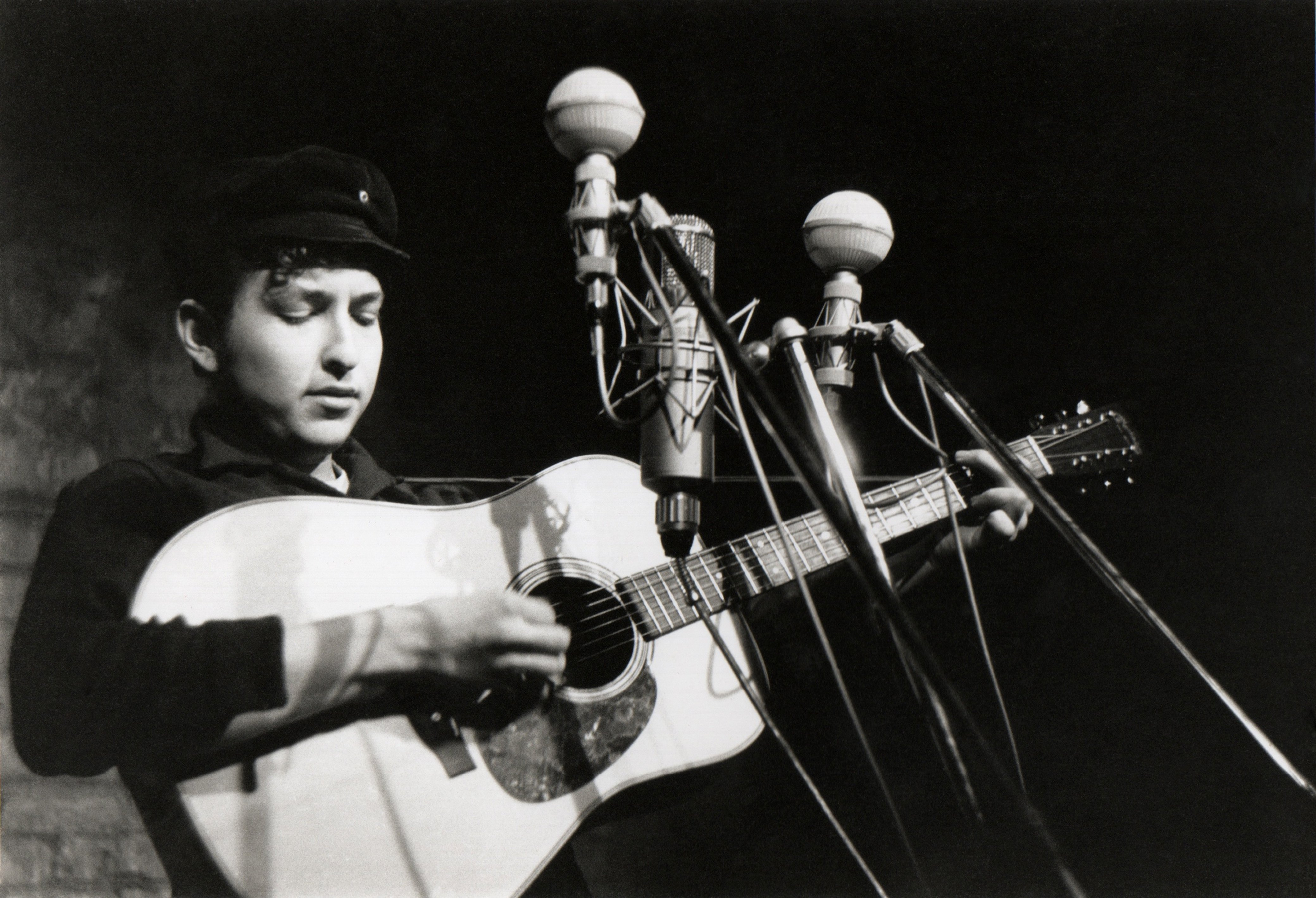 Bob Dylan performs at The Bitter End folk club in Greenwich Village in 1961 in New York City, New York.