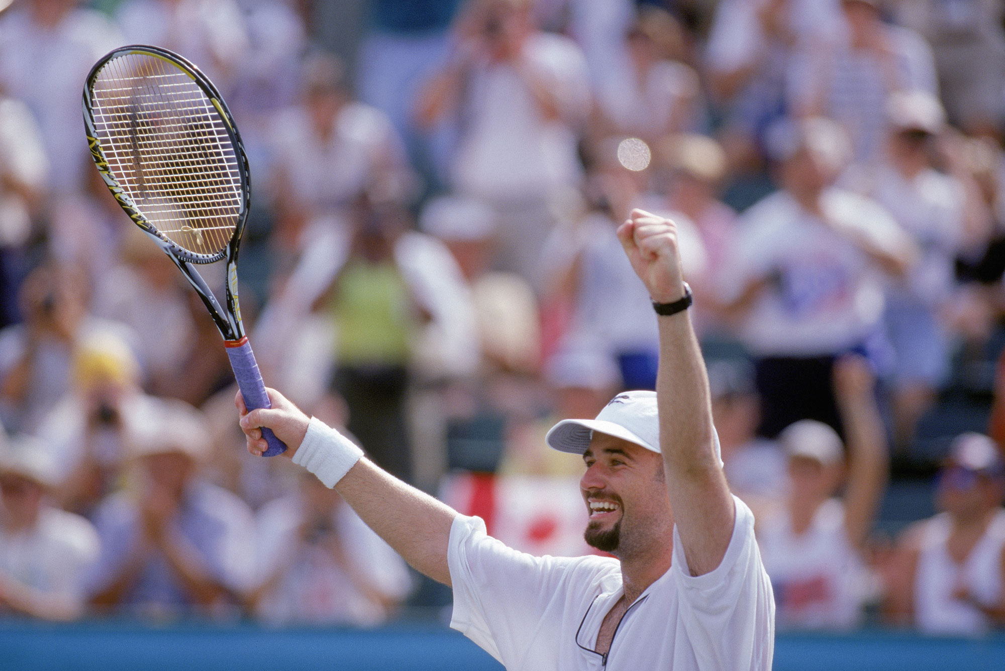 982fa3f3fa ATLANTA - AUGUST 3: Andre Agassi celebrates after defeating Sergi Bruguera  of Spain for the