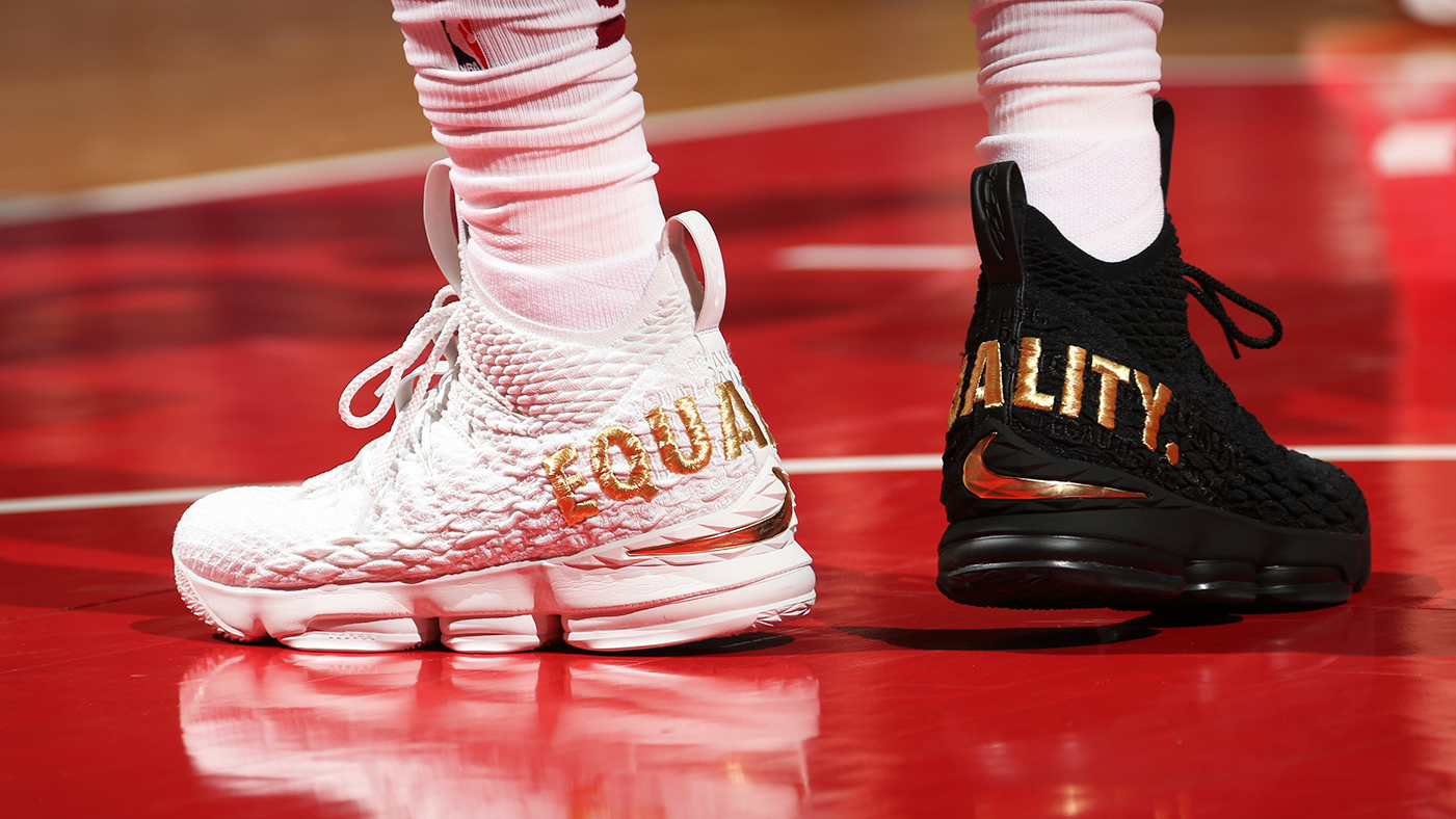 362bb0e64 LeBron James Sends Message of Equality With One Black, One White Sneaker.