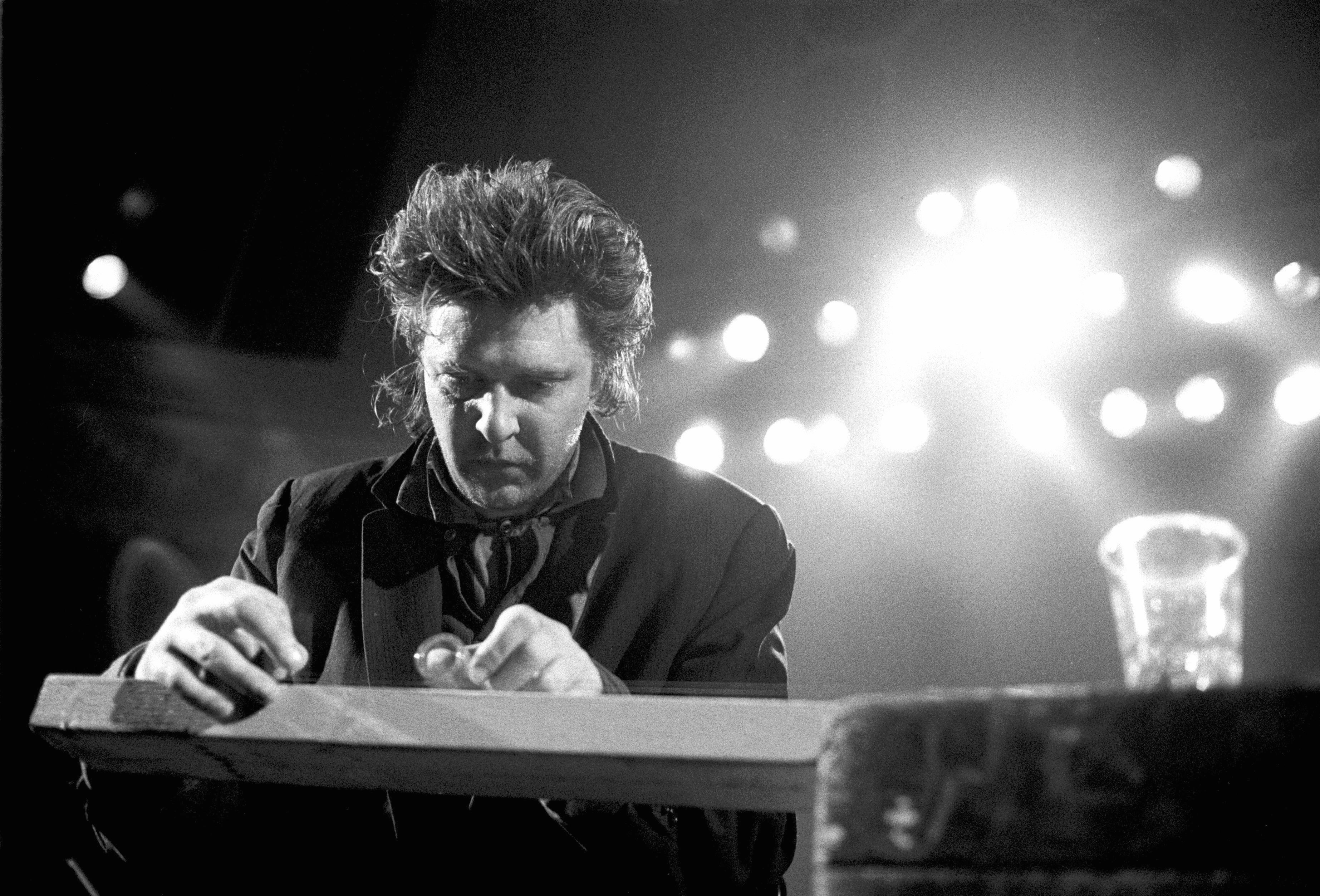 6e1c09362 American composer and guitarist Glenn Branca performs live on stage at the  Paradiso in Amsterdam