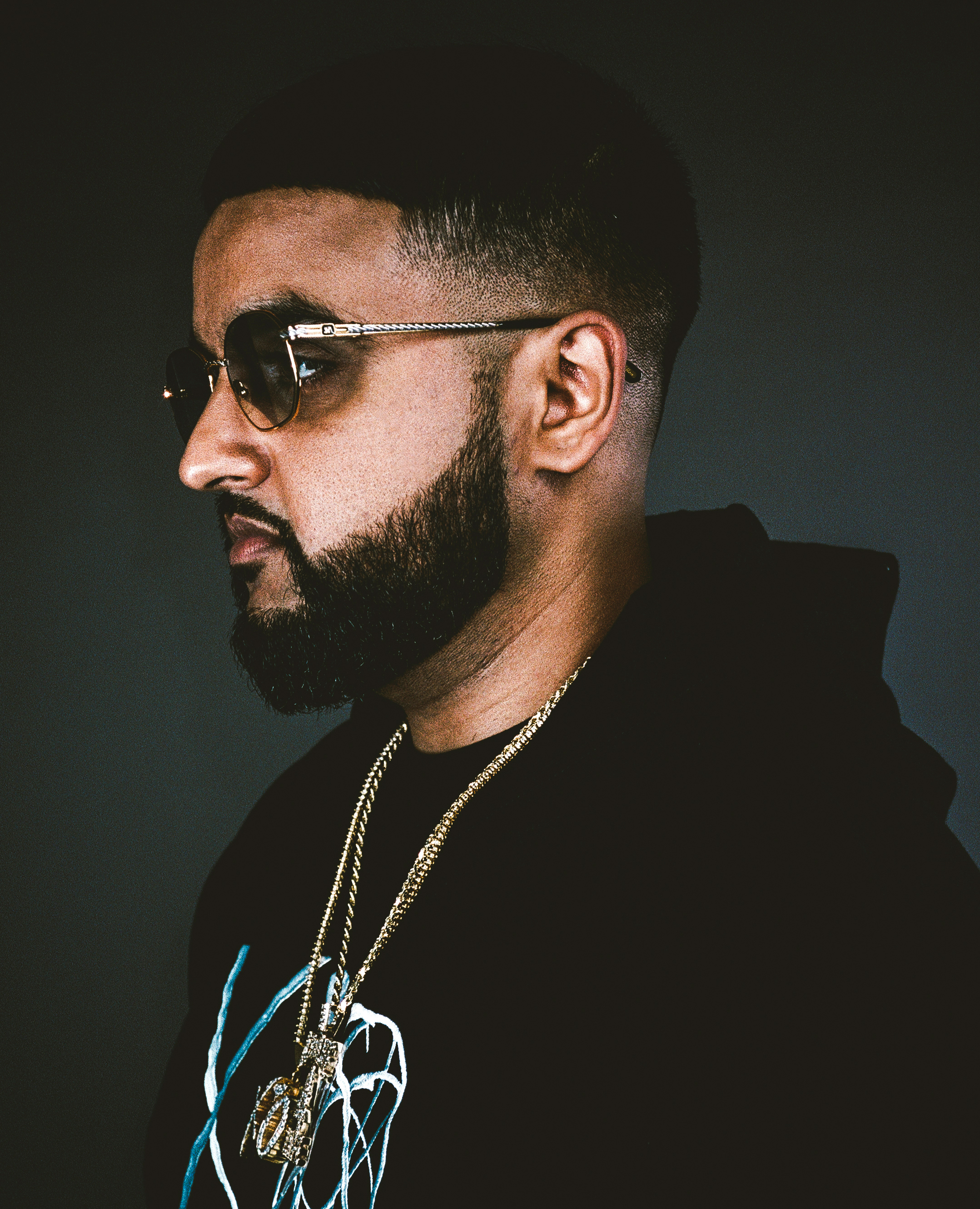 The 29-year old son of father (?) and mother(?) Nav in 2019 photo. Nav earned a  million dollar salary - leaving the net worth at  million in 2019