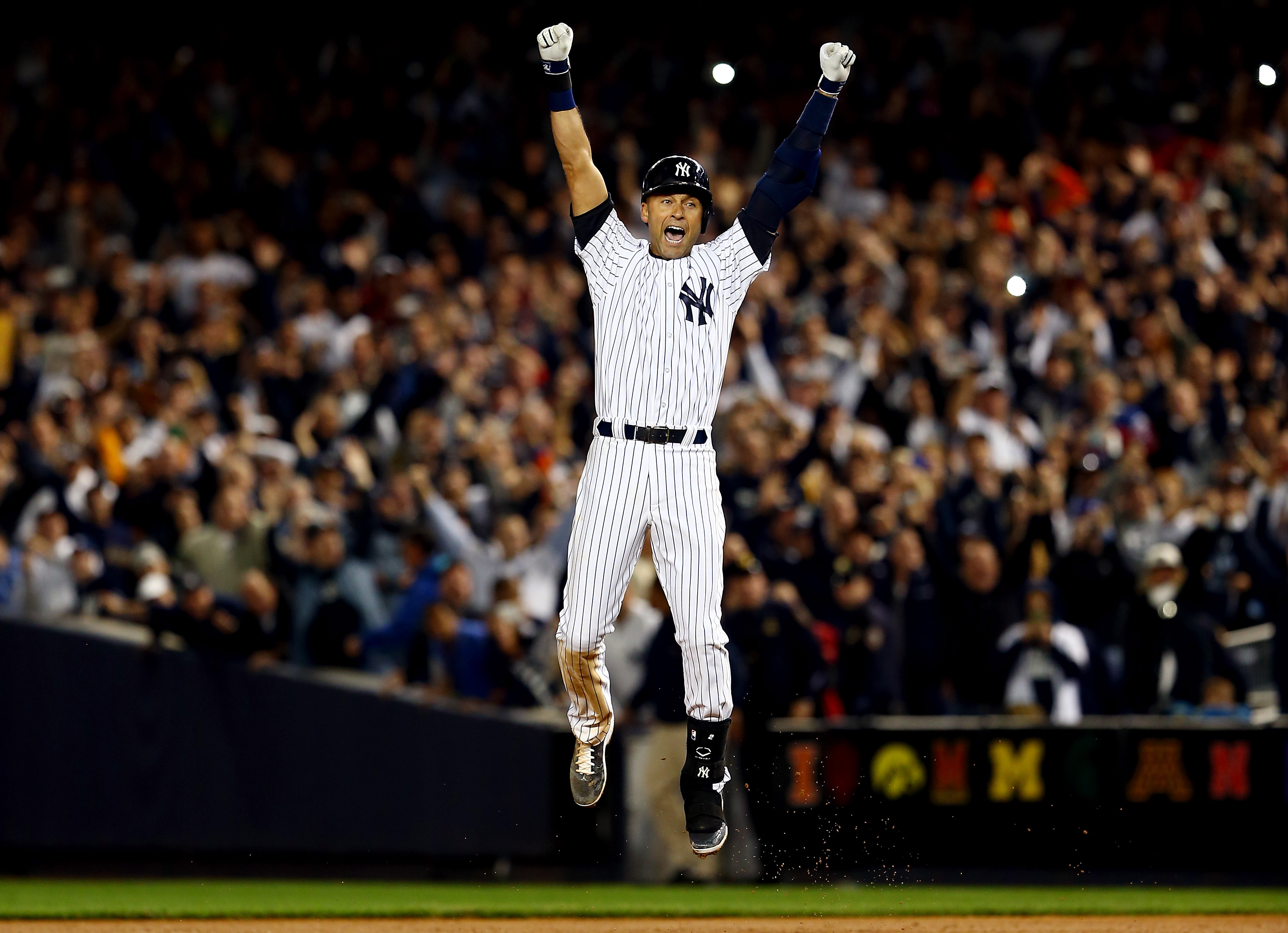 8eb19638f93 Derek Jeter celebrates after a game winning RBI hit in the ninth inning  against the Baltimore
