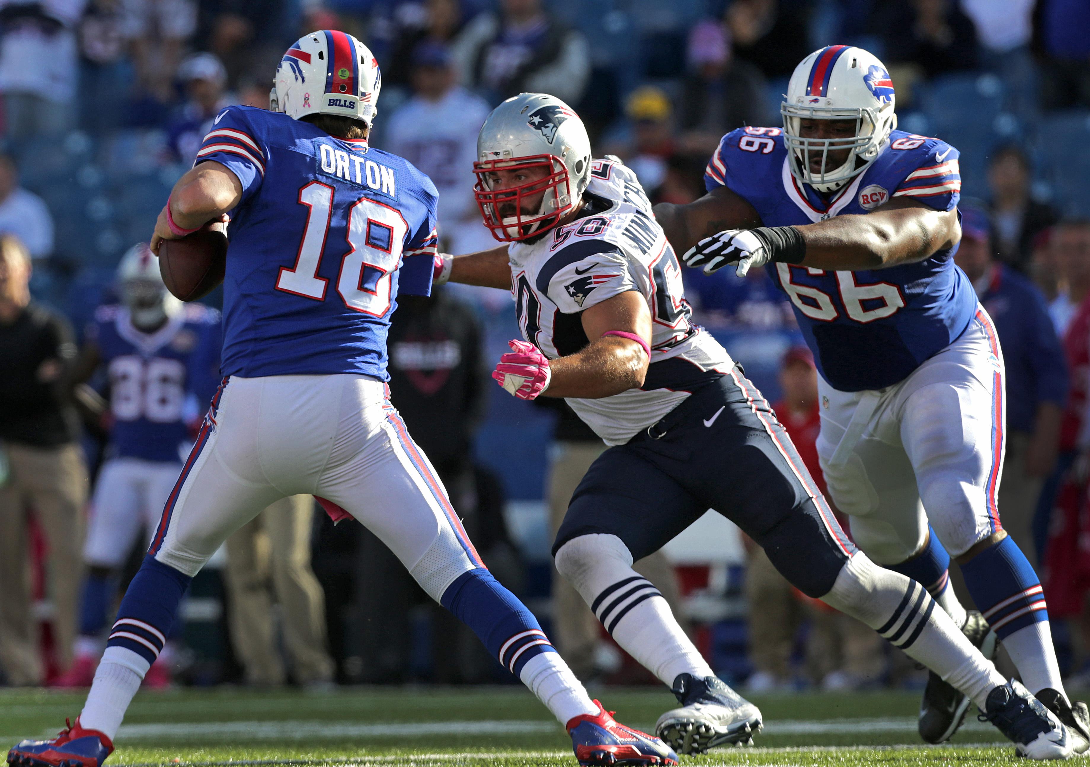 c0ee85708fb New England Patriots defensive end Rob Ninkovich lines up Buffalo Bills  quarterback Kyle Orton for a sack.