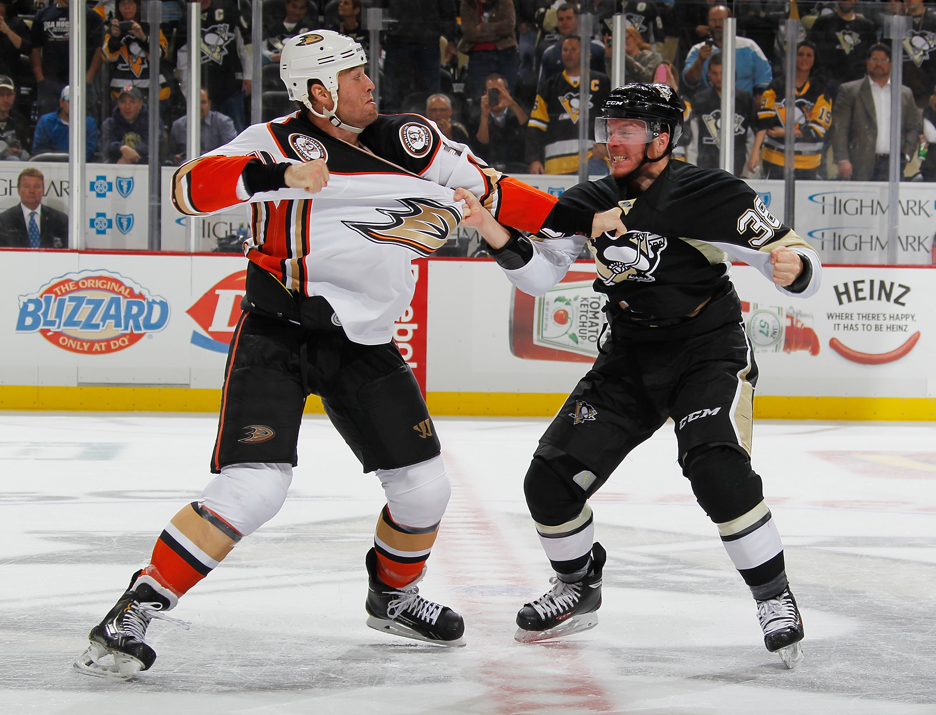Zach Sill of the Pittsburgh Penguins and Clayton Stoner of the Anaheim  Ducks fight during the 53984f169bde