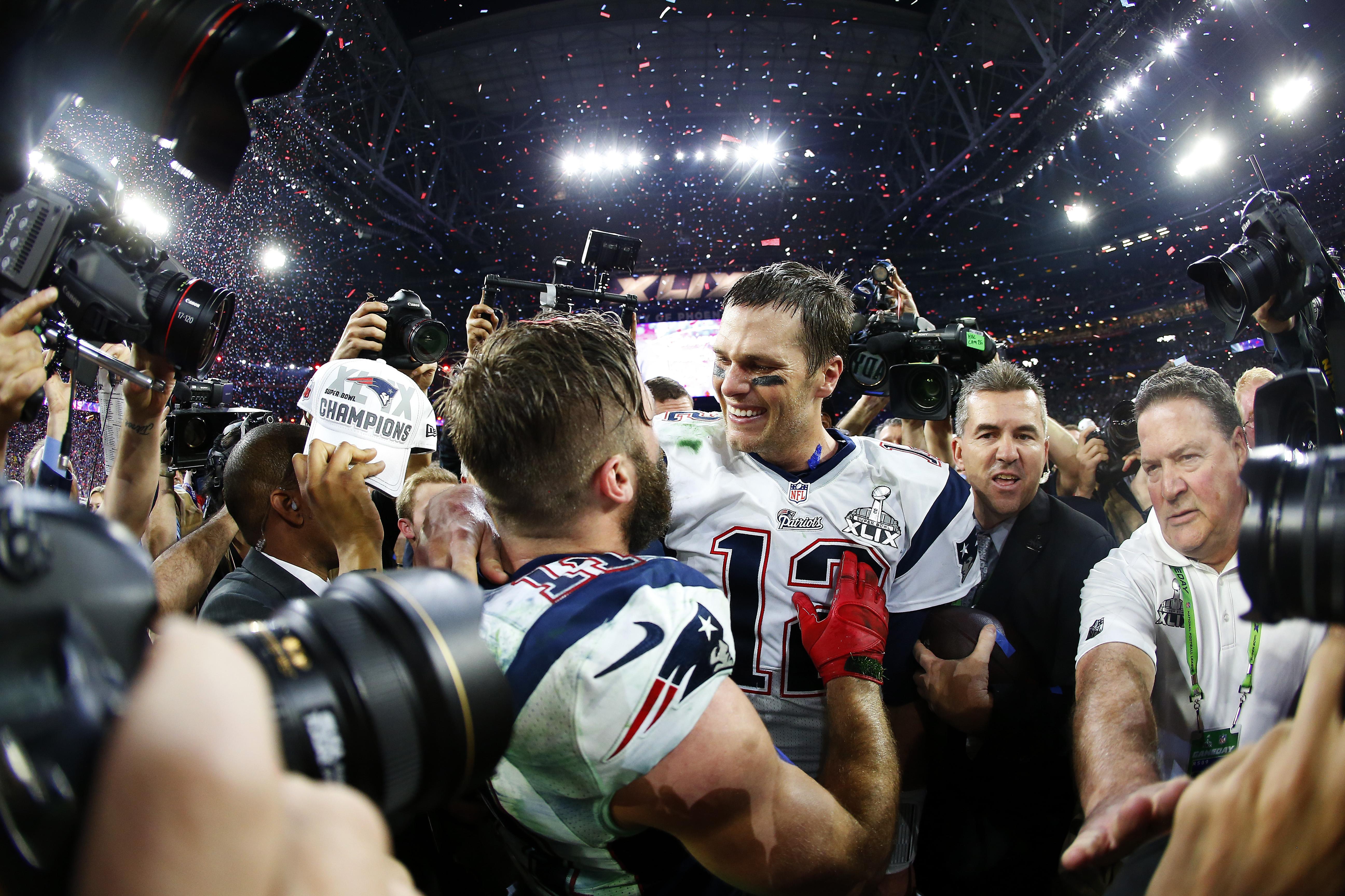 Tom Brady and Julian Edelman of the New England Patriots celebrate after  Super Bowl XLIX. 1db12ab3045