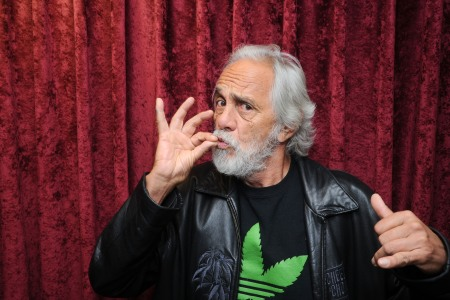 Tommy Chong smoking a cigarette (or weed)