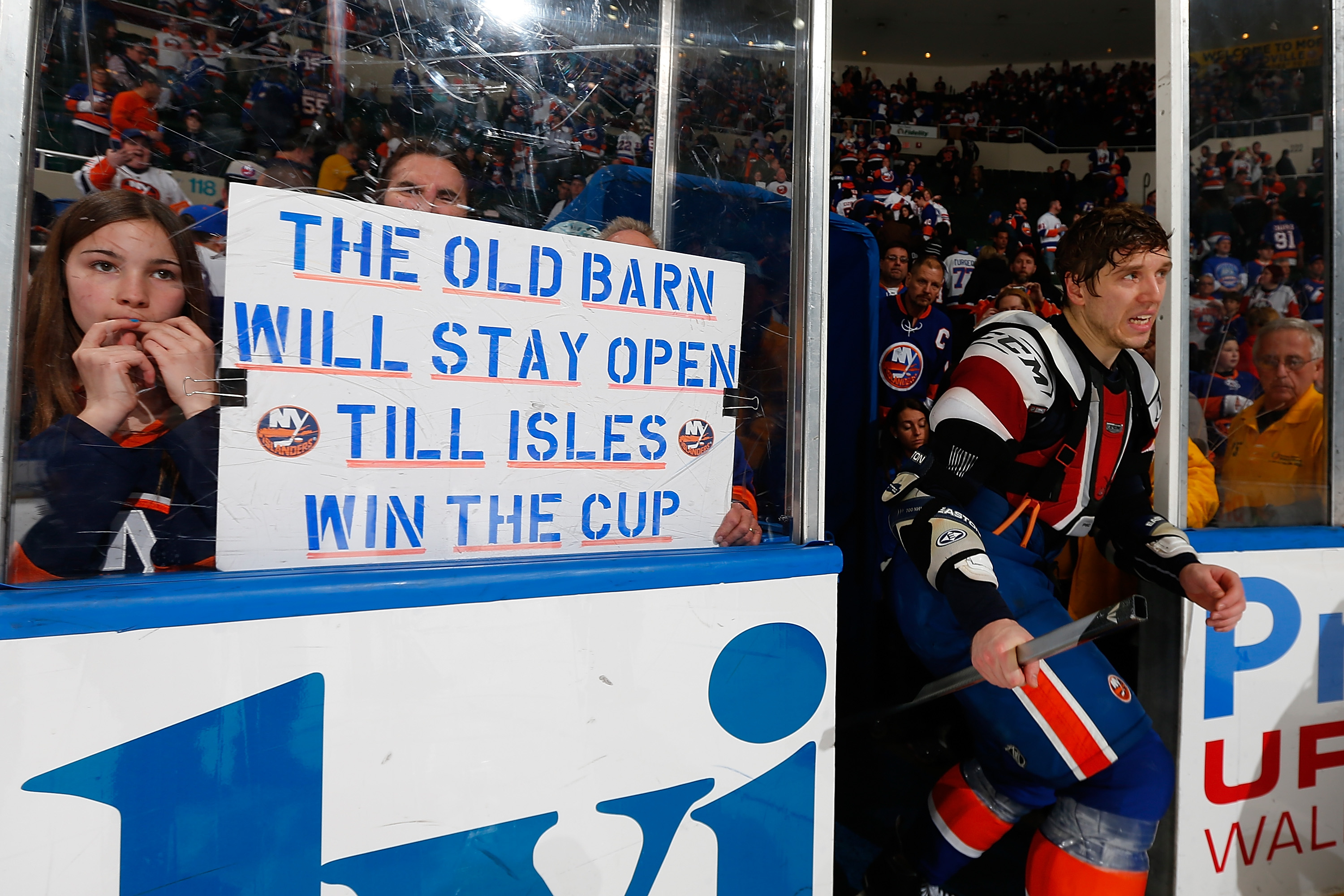 A fan holds a sign during the New York Islanders final regular-season game  at the Nassau Coliseum. e493139a5