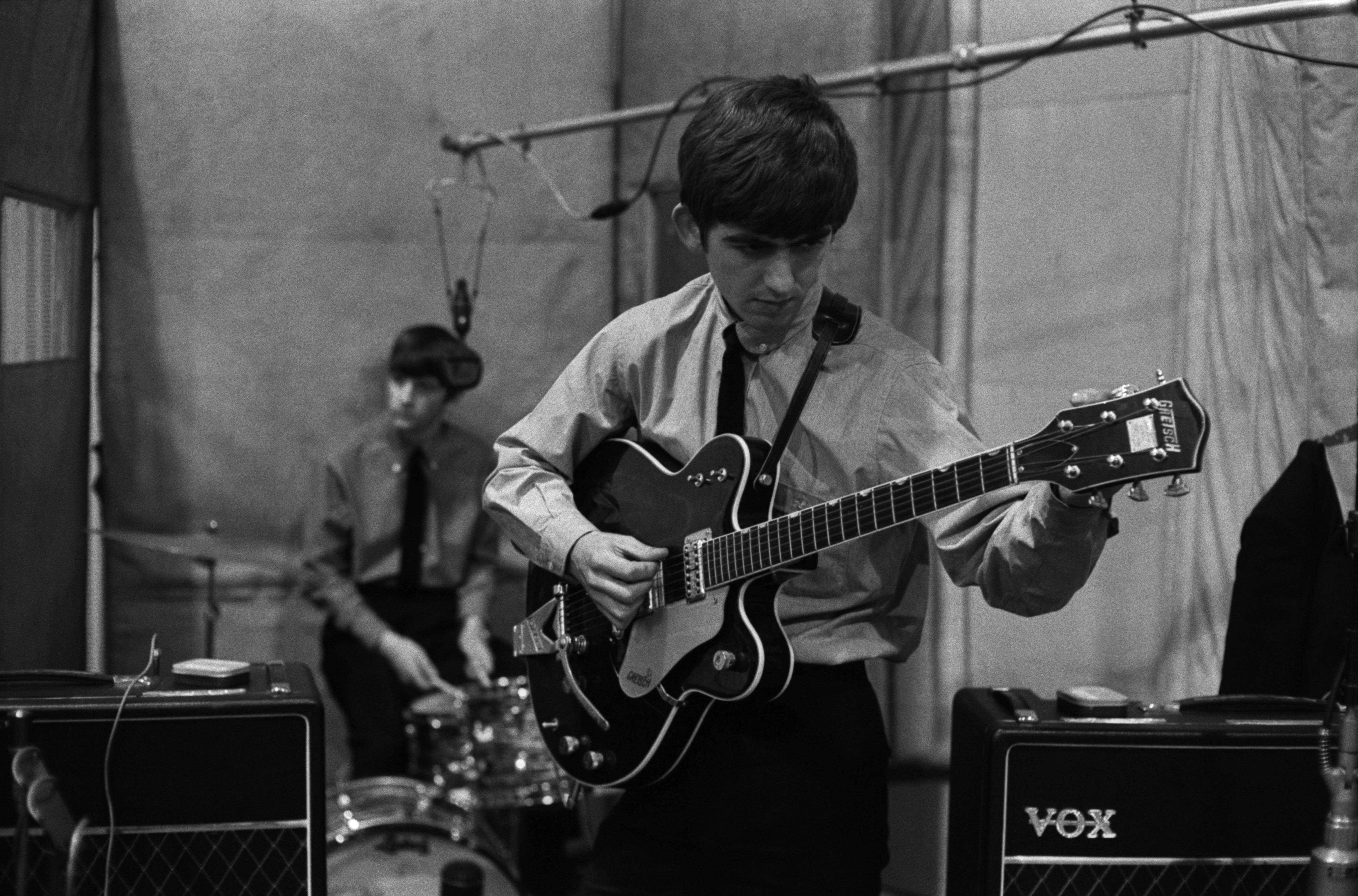 George Harrison Playing His Gretsch Country Gentleman Guitar In 1963 A Used By The Summer Of While This Was Being Repaired
