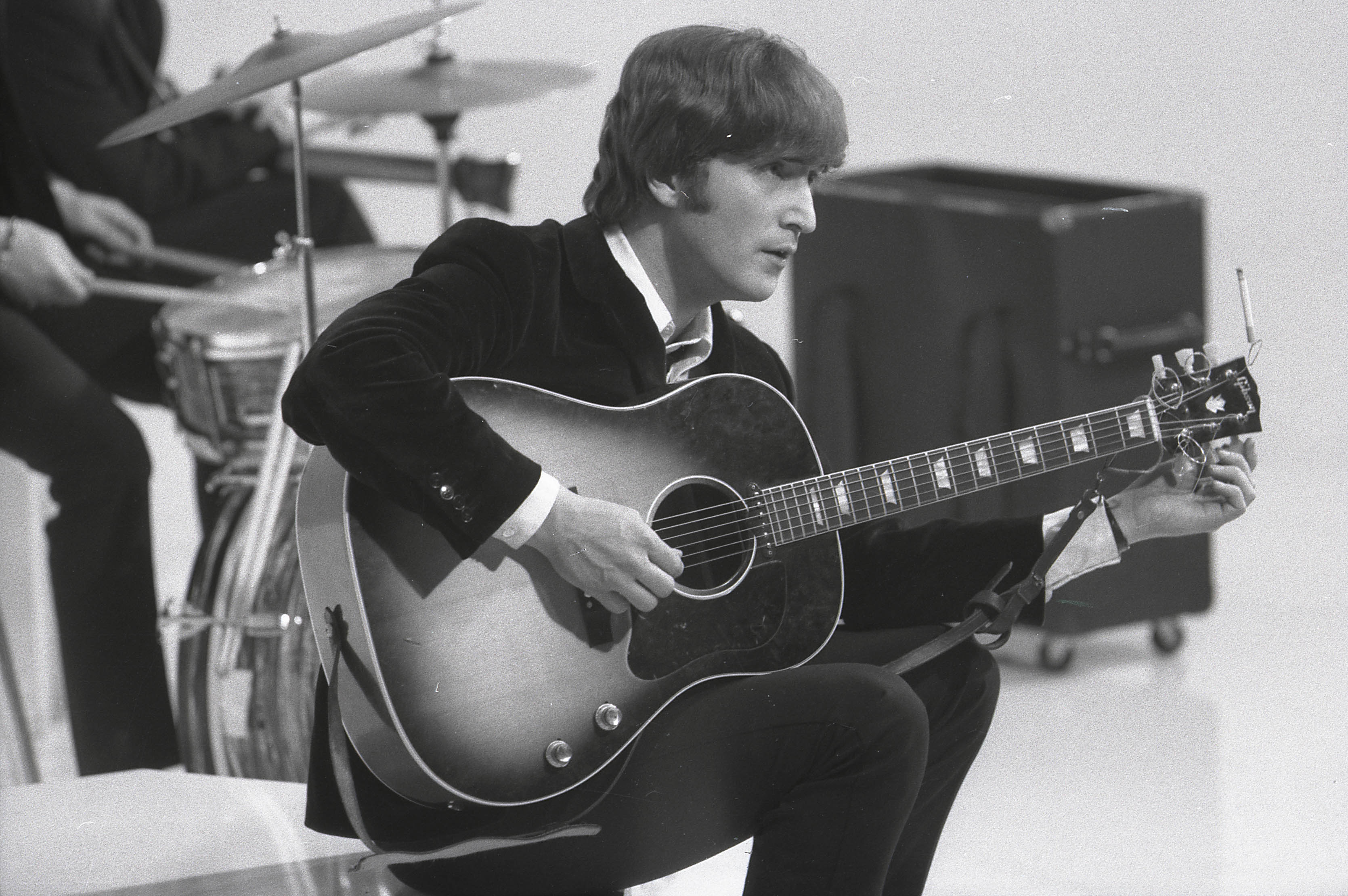John Lennon Tuning His Replacement Gibson J160E Acoustic Guitar During The Filming Of A Hard Days Night At Scala Theatre In 1964
