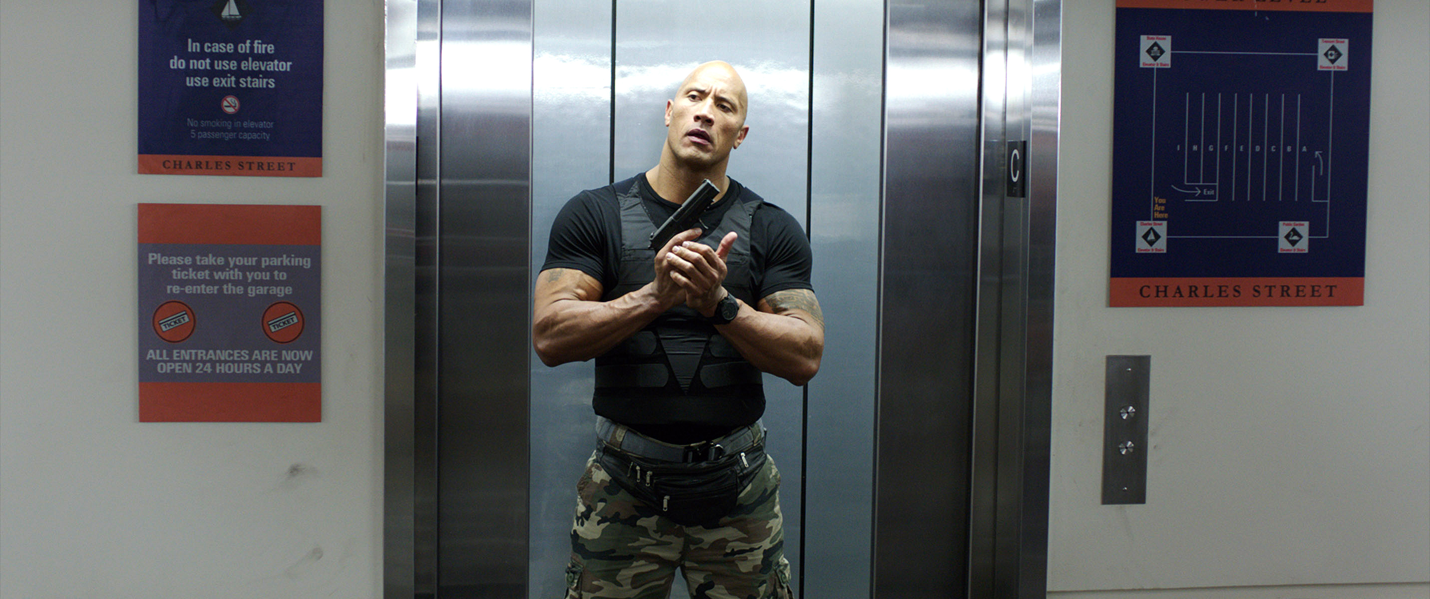 How the rock turned back into dwayne johnson rolling stone dwayne johnson holding gun central intelligence movie a list actor m4hsunfo
