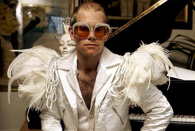 Photos Elton John\u0027s Outfits Through the Years