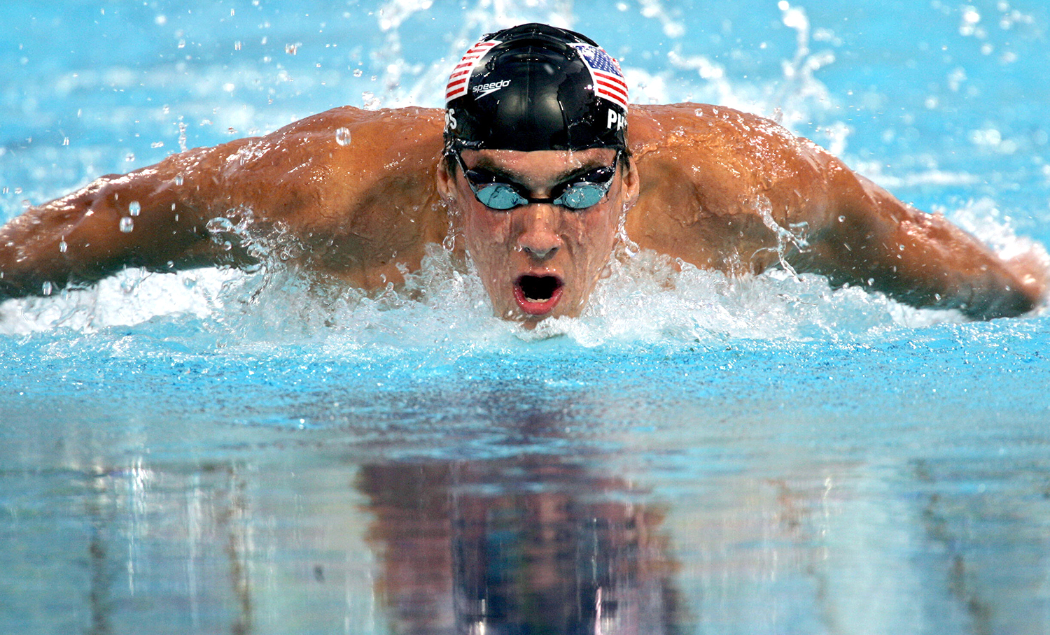 michael phelps to race great white shark for shark week rolling