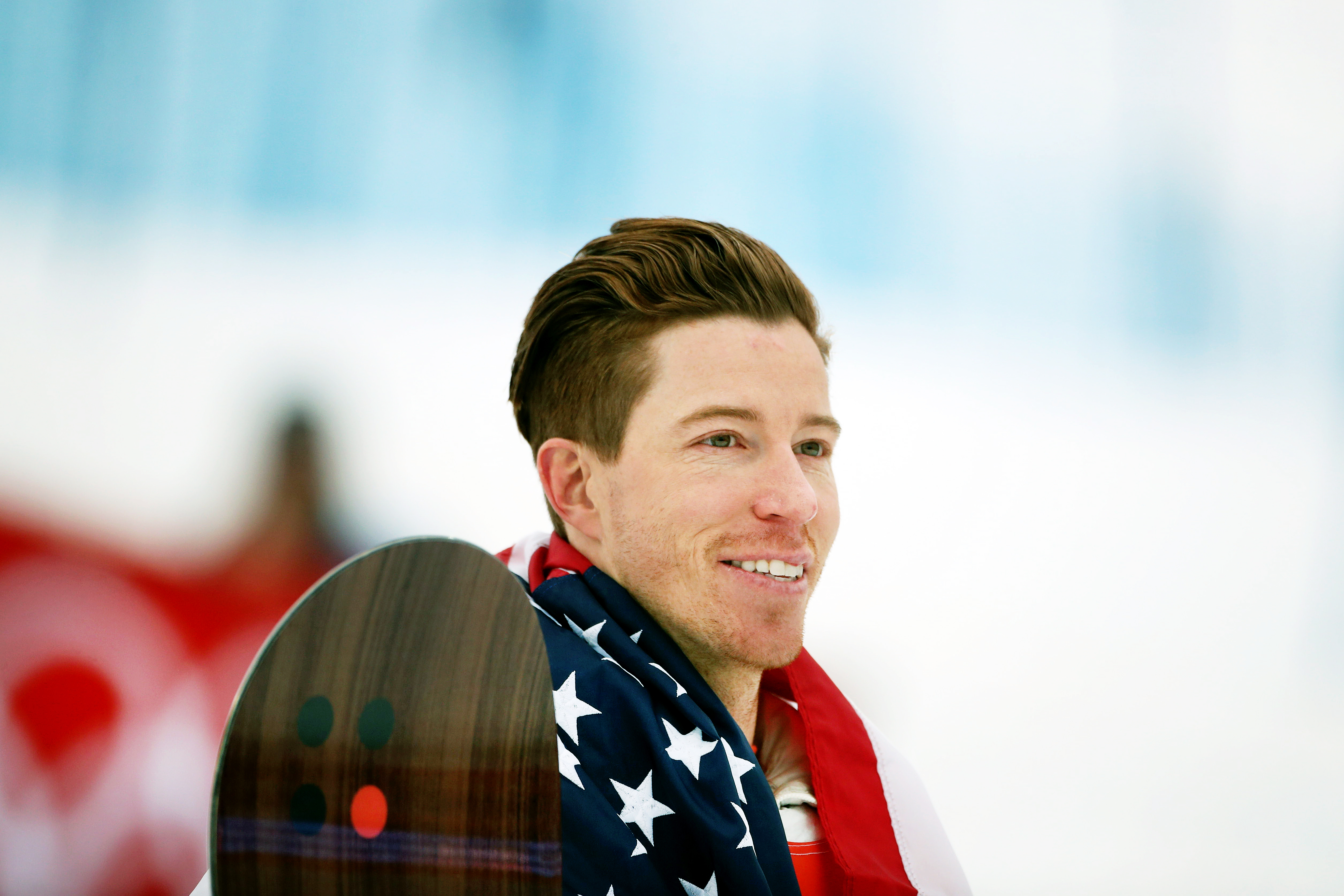 ce4746b5a8f1 Shaun White of the United States celebrates with the American flag after  winning the gold medal