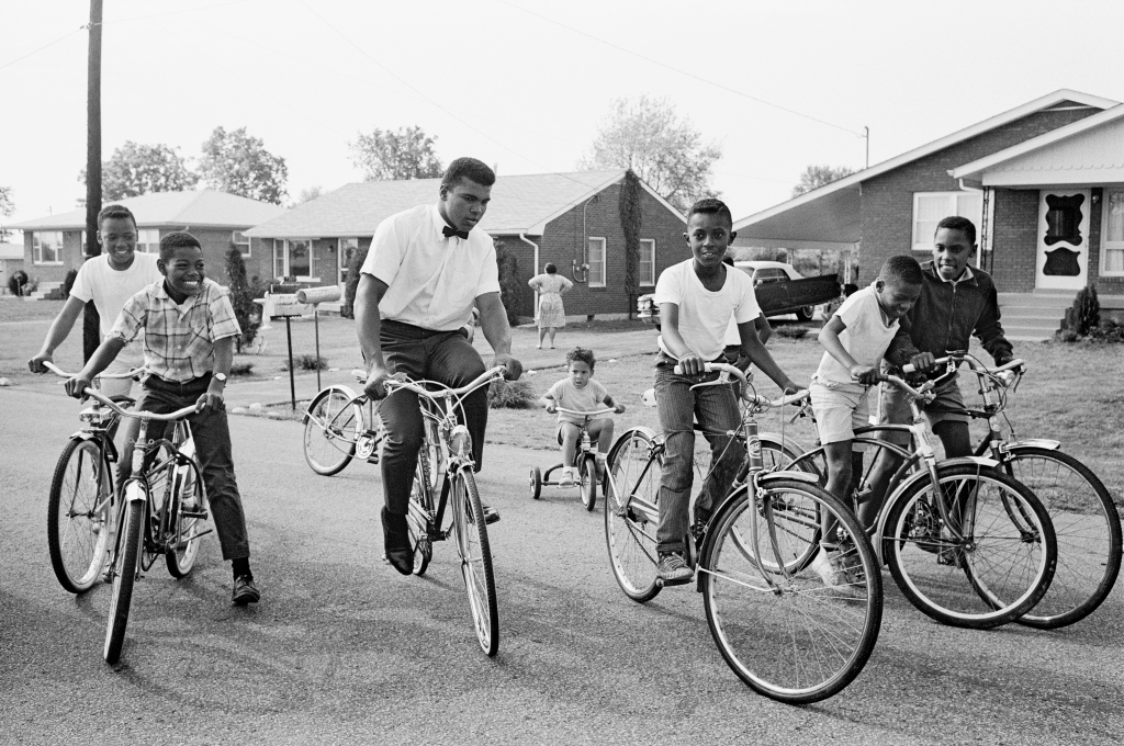 """""""He loved riding his bike with the kids,"""" Shapiro says. """"The kids in the neighborhood loved him. They all come to his house and fool around and can hit him, in a happy way. He would also play Monopoly with the kids all the time; he walked around town carrying his Monopoly [set] under his arm. He really loved the kids in a big, big way —and they certainly loved him."""""""