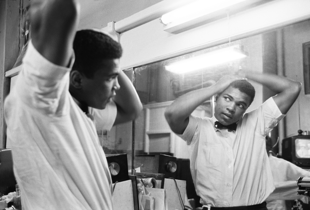 """""""There were a number of pictures of him combing his hair,"""" says Schapiro. """"He was very happy with himself, as well he should be. Here he was on top of the world — starting off as a boxer [and] already [with a] reputation where people were just beginning to look at him. How could you not feel that way? And still be looking pretty in the mirror, no scars, no marks, everything fine."""""""