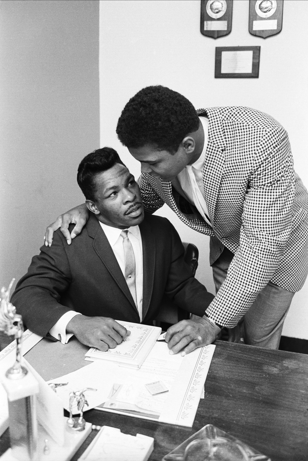 """Ali idolized Sugar Ray Robinson, a legendary boxer who owned his own gym in Harlem, New York. """"His real hero was Sugar Ray,"""" says Schapiro. """"And he had an appointment to meet Sugar Ray in New York at Sugar Ray's gym. We all got in [Ali's] car and we drove. As we were driving, he was shouting out the window at everybody. And we drove along like that, in high spirits. And we got to Sugar Ray's gym and we were there, and we waited for Sugar Ray to come. We we're waiting and we're waiting more, and then it became slowly obvious that Sugar Ray was not coming to the gym. And for the first time on that trip, Mohammad became very, very quiet. And then we got back in the car and we drive down 125th street, and quite by accident we saw Sugar Ray walking."""" They stopped, and the entourage went into Robinson's office. """"The two just got along famously,"""" Schapiro says. """"Y'know, this was a very, very big deal for [Ali.] Here he was, meeting his hero. And here he was because [Robinson] knew who he was. Being Ali, he knew, 'I'm gonna be the champ some day.'"""""""