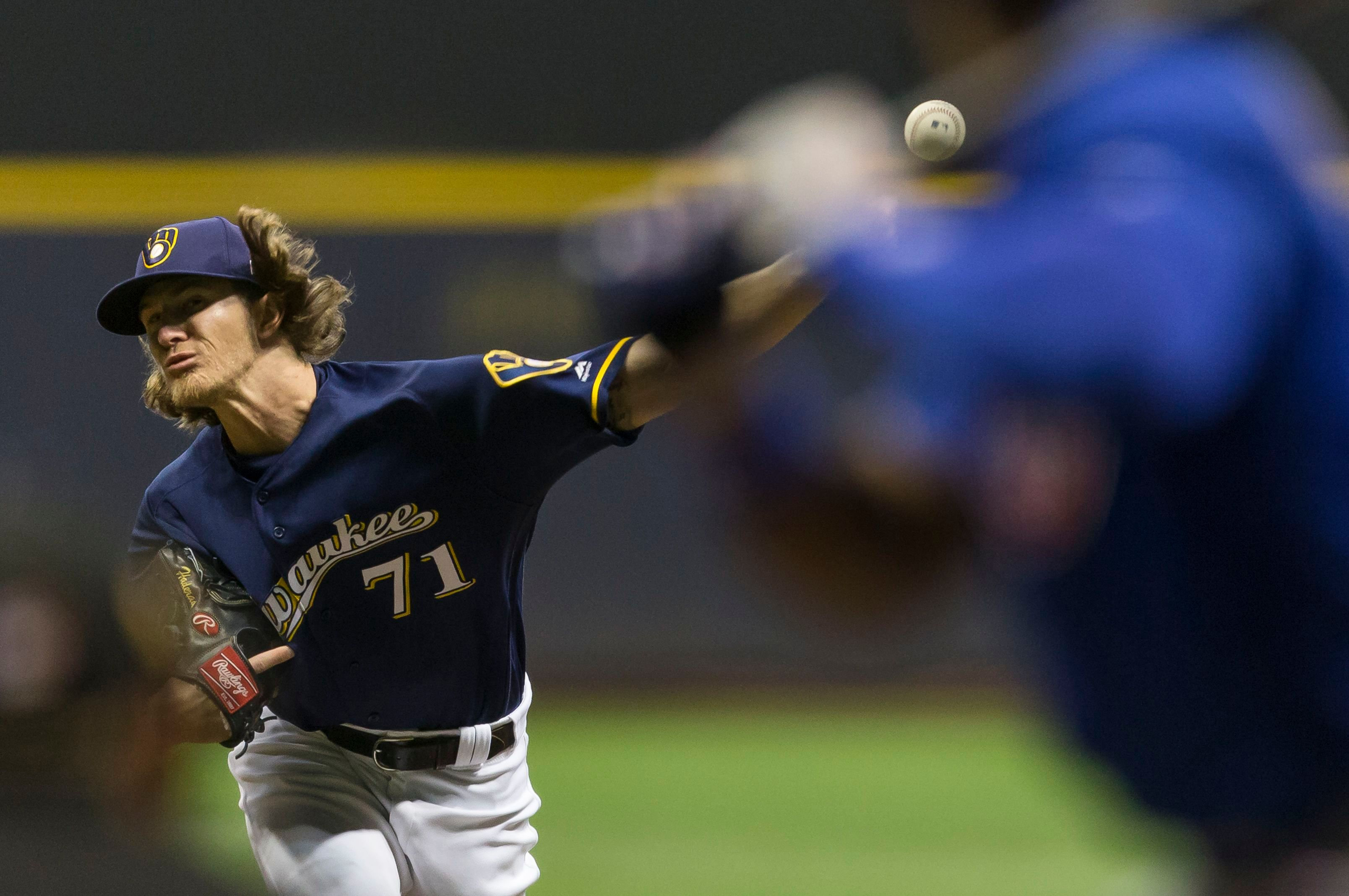 1d5164321 Milwaukee Brewers relief pitcher Josh Hader 71 delivers a pitch during the Major  League Baseball ...