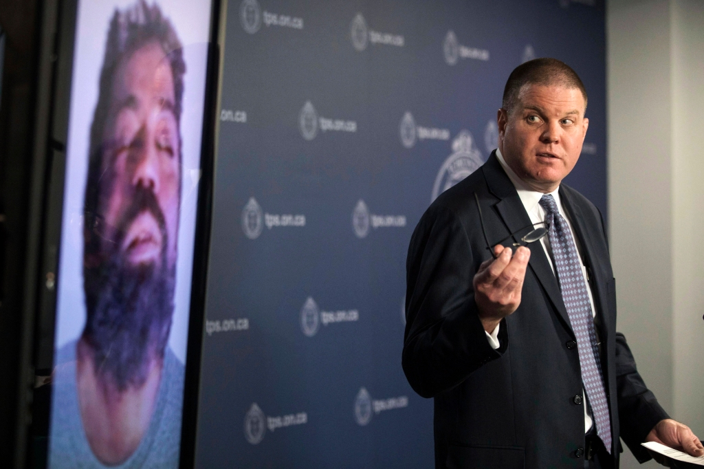 "In this March 5, 2018 photo, Sgt. Hank Idsinga, lead detective in the case against alleged serial killer Bruce McArthur, gives a news conference at police headquarters in Toronto, Canada. Police don't know how many potential victims there could be, but they are reviewing hundreds of missing person reports in Toronto as well as elsewhere in Canada and places where McArthur has traveled, including Italy and Mexico. ""We are tracing his whereabouts as far back as we can go,"" said Idsinga. (Chris Young/The Canadian Press via AP)"