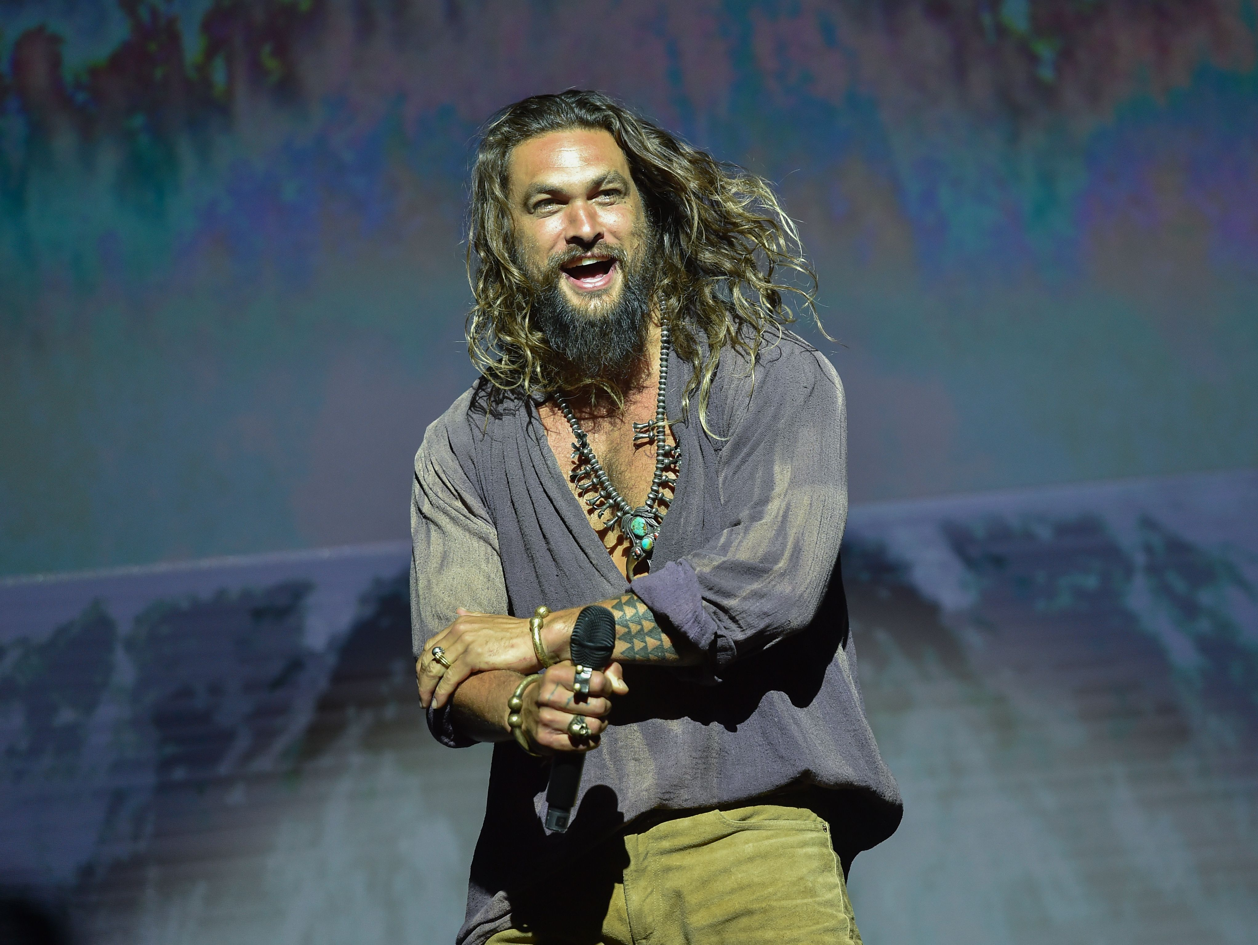 9831113a96a77 Cast member Jason Momoa participates on stage during the Warner Bros.  Theatrical Panel for