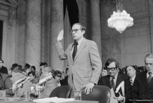 (Original Caption) Testifying for the second day before the Senate Watergate Committee, John W. Dean III, said he was sure that President Nixon not only knew about the Watergate cover-up as early as last fall, but also helped try to keep the scandal quiet.
