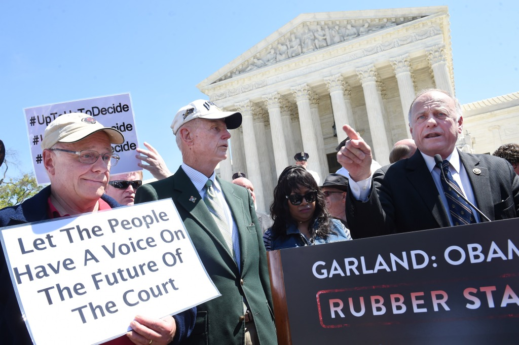WASHINGTON, DC- APRIL 18: U.S. Representative Steve King (R-IA), right, speaks outside the Supreme Court of the United States on Monday April 18, 2016 in Washington, DC. Monday the court heard a case that centers on President Barack Obama's immigration policy that would prevent many people from being deported. King made remarks towards protesters who were chanting and yelling as he spoke. (Photo by Matt McClain/ The Washington Post via Getty Images)