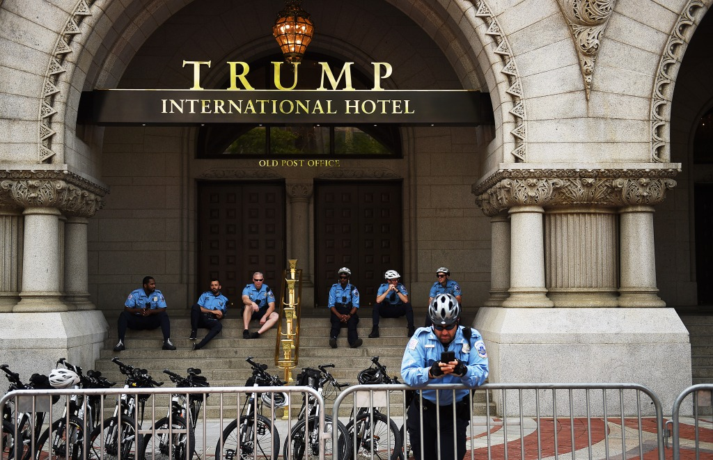 WASHINGTON, DC - APRIL 29: Police officers wait for the marchers in the entrance of the Trump International Hotel which they are assigned to protect during the People's Climate Movement to protest President Donald Trump's enviromental policies April 29, 2017 in Washington, DC. Demonstrators across the country are gathering to demand a clean energy economy. (Photo by Astrid Riecken/Getty Images)