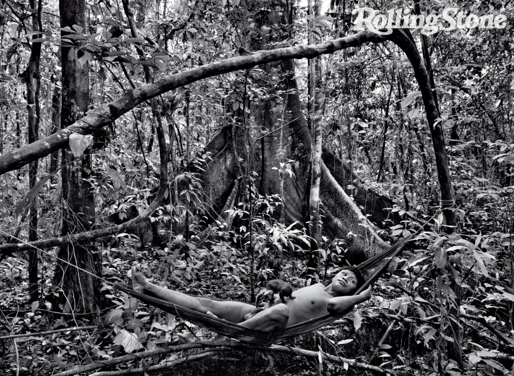 """Ayax Punu relaxes with a brown titi monkey. """"When you come out of your hammock, you must look around for snakes, scorpions, spiders,"""" says Salgado. And """"you must always have a small fire when you are sleeping,"""" he adds, to keep jaguars away."""