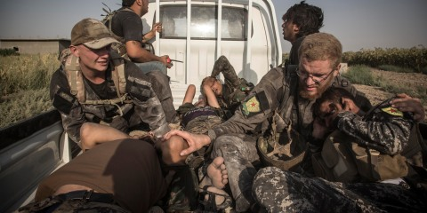Members of the Antifa Platoon help evacuate Arab soldiers after a car bomb. Photo by Pedro Brito Da Fonseca