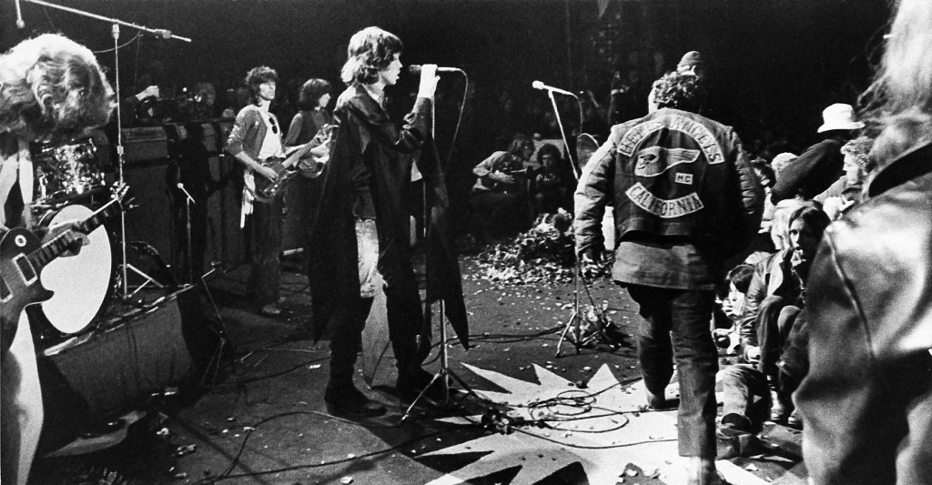 Mick Jagger Mick Jagger sings at the Altamont Rock Festival at Livermore, Calif. on while Hells Angels cross stage during melee to help fellow motorcyclists. The Rolling Stone hired the Hells Angels to police the concert for $500 worth of beerStones Altamont, LIVERMORE, USA