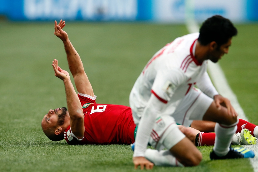 June 15, 2018 - St Petersburg, United Kingdom - Noureddine Amrabat of Morocco lies unconscious following a tackle with Vahid Amiri of IR Iran during the FIFA World Cup 2018 Group B match at the St Petersburg Stadium, St Petersburg. Picture date 15th June 2018. Picture credit should read: David Klein/Sportimage (Cal Sport Media via AP Images)