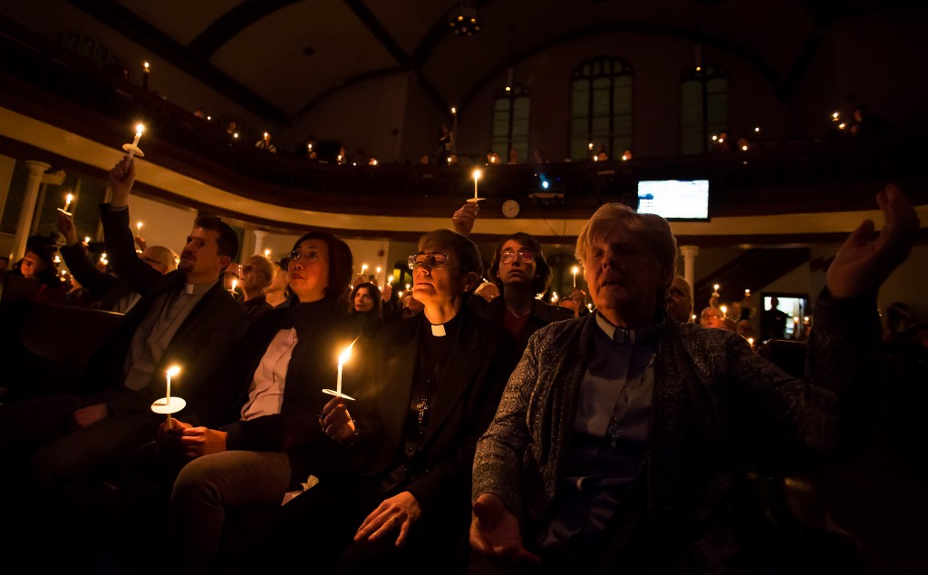 A vigil for the murder victims at the predominantly gay Metropolitan Community Church in Toronto, Feb. 4, 2018. After police charged a landscaper with the murders of five men, gay activists asks why it took so long, accusing the authorities of neglect in missing-person cases involving gay men. (Tara Walton/The New York Times)
