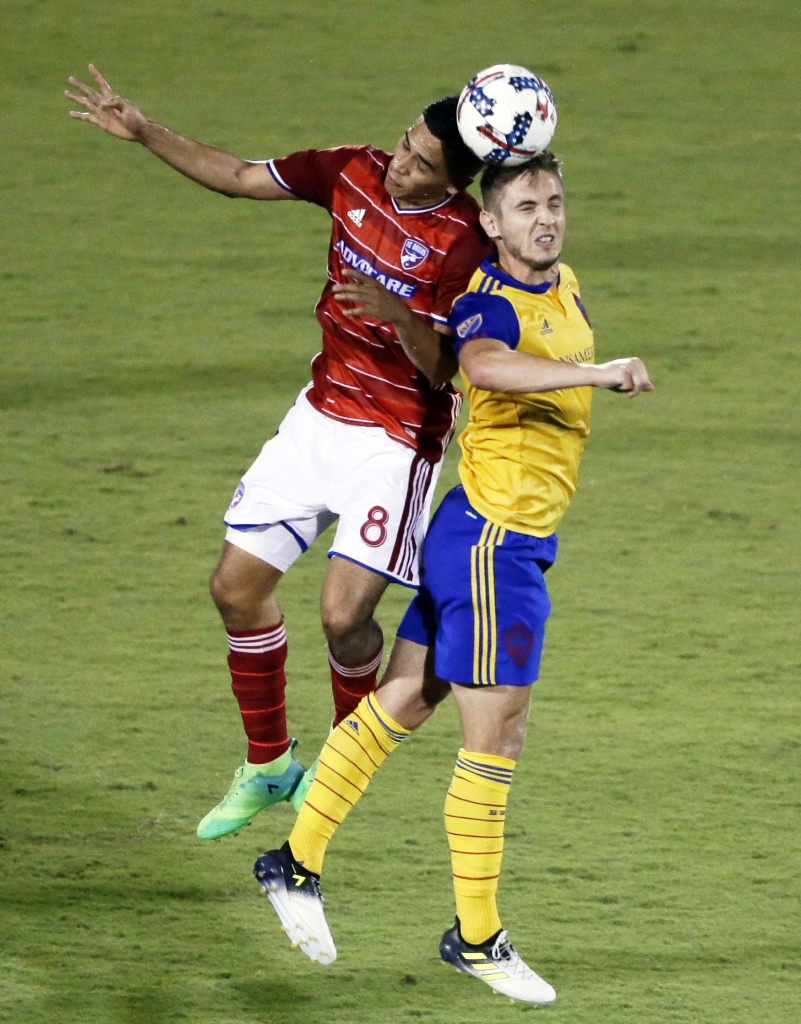 Victor Ulloa, Kevin Doyle FC Dallas midfielder Victor Ulloa (8) and Colorado Rapids forward Kevin Doyle, right, attempt to head the ball in the second half of an MLS soccer game, in Frisco, TexasMLS Rapids FC Dallas Soccer, Frisco, USA - 12 Aug 2017