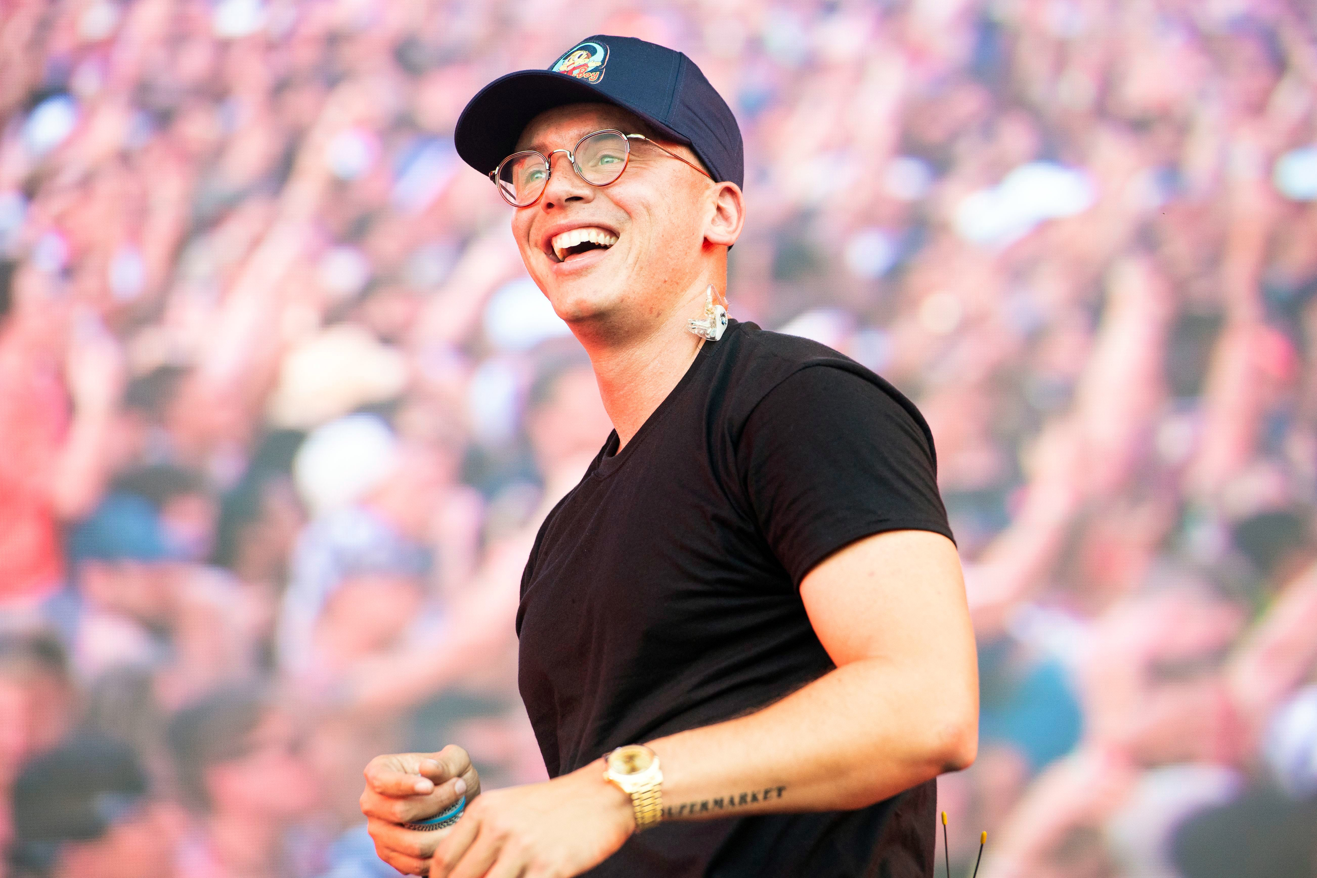hear logic s optimistic new song one day with ryan tedder
