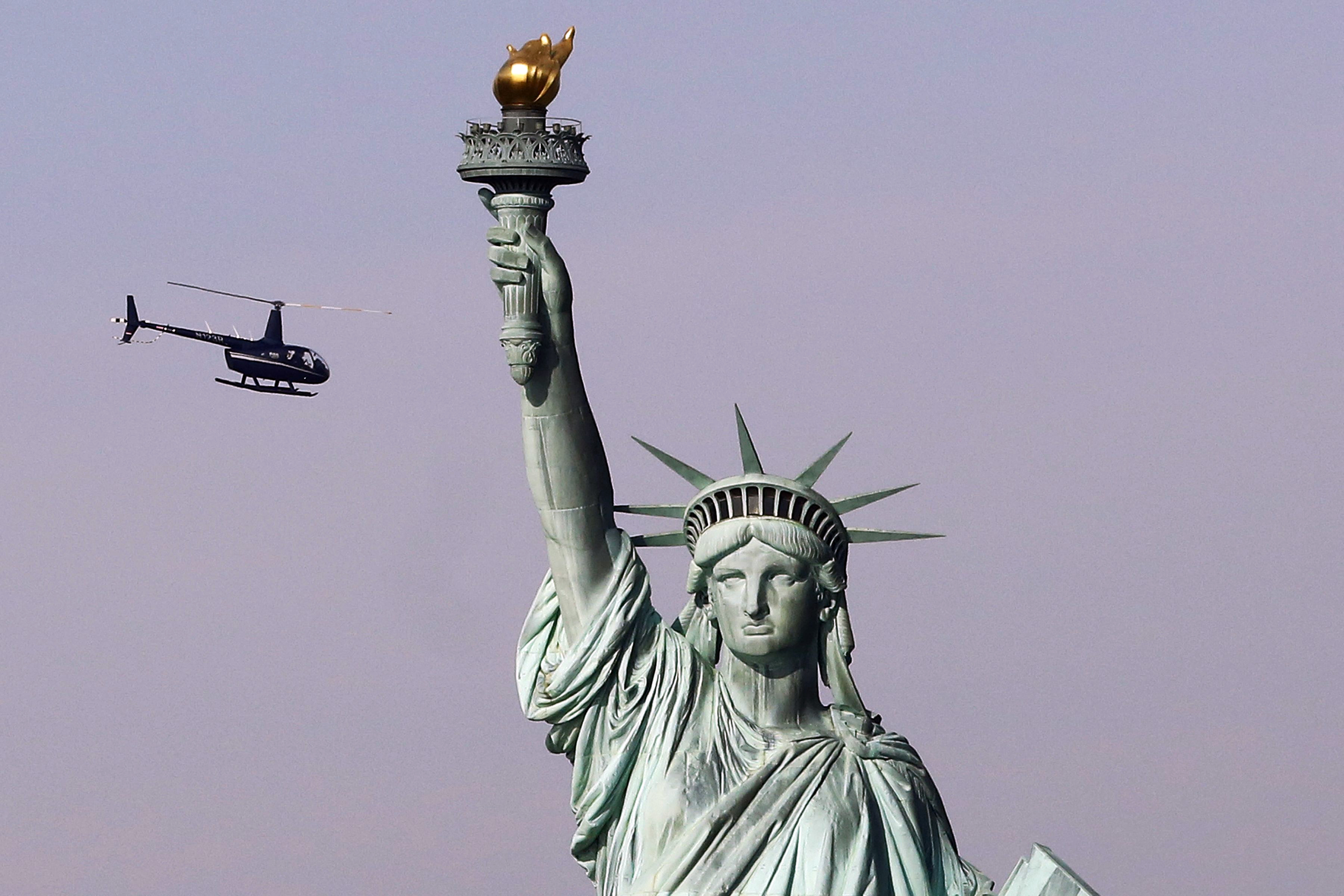 Abolish Ice Woman Climbs Statue Of Liberty To Protest Trumps