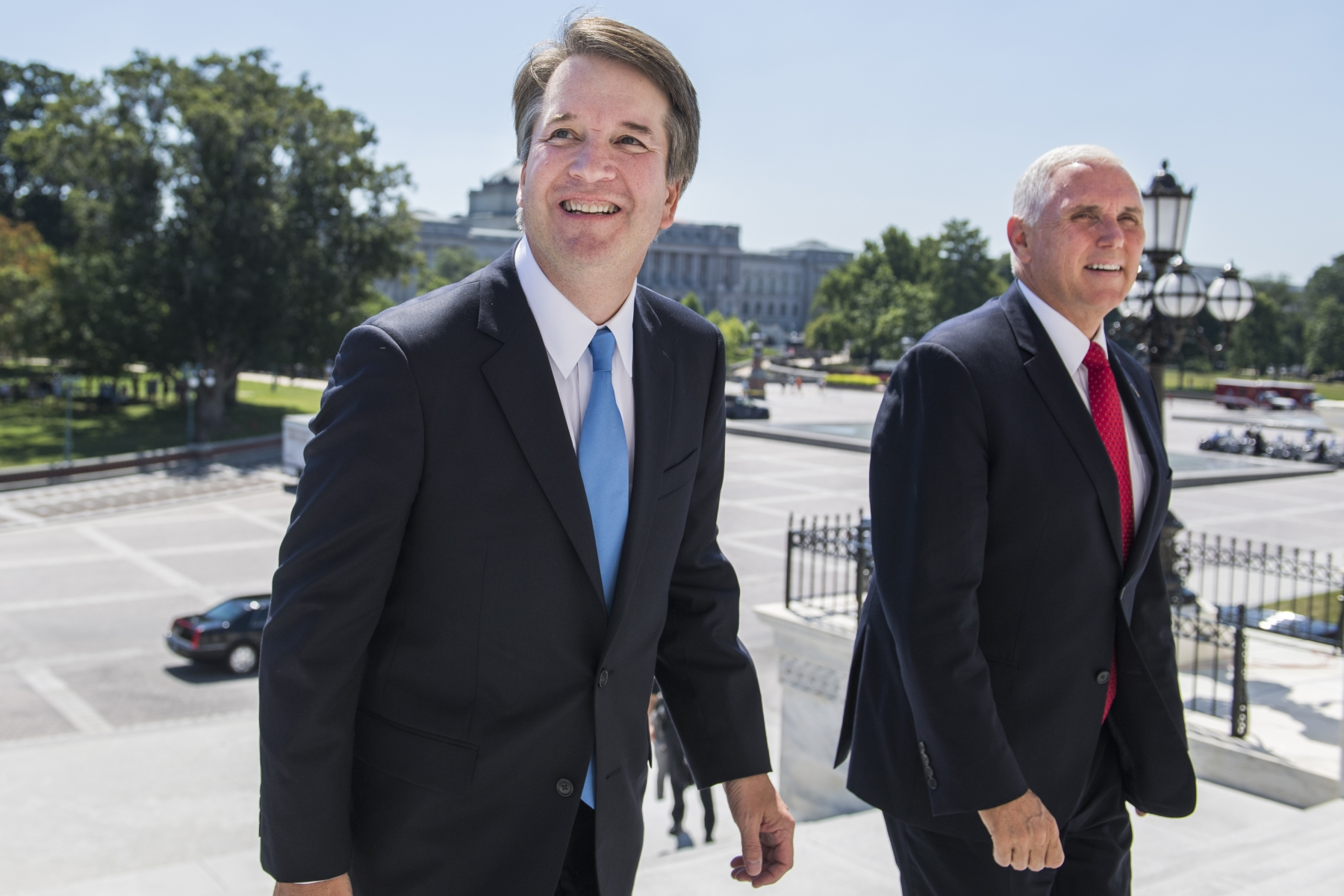 July 10, 2018 - Washington, District of Columbia, U.S. - UNITED District of ColumbiaS - JULY 10: Supreme Court nominee Brett Kavanaugh, left, walks up the the Capitol's Senate steps with Vice President Mike Pence for a meeting with Senate Majority Leader Mitch McConnell, R-Ky., on July 10, 2018. (Photo By Tom Williams/CQ Roll Call) (Credit Image: © Tom Williams/Congressional Quarterly/Newscom via ZUMA Press)