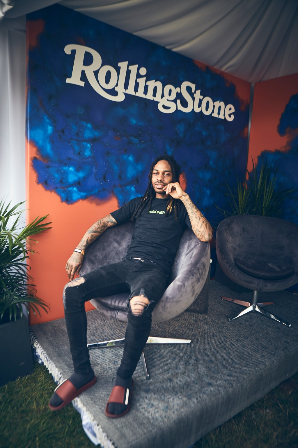 Chicago's own Valee lounges at the Rolling Stone tent.