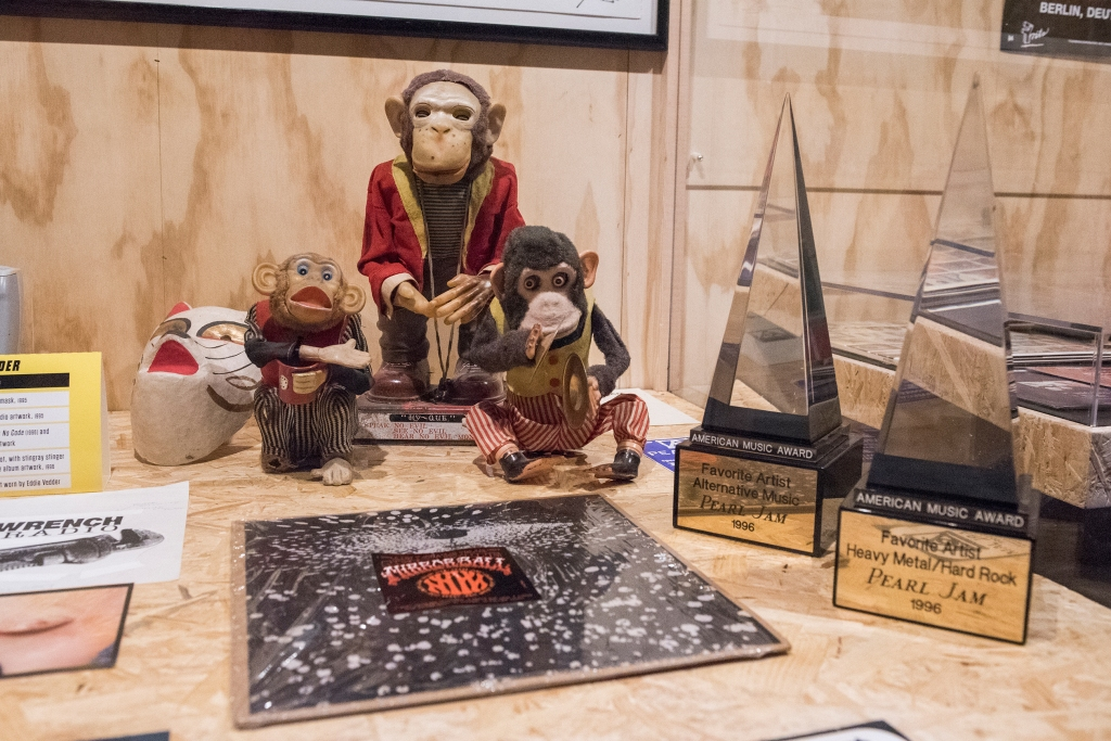 Guitarist Mike McCready's monkey toy amplifier ornaments. Also: Mirror Ball, the band's 1995 album with Neil Young, and their 1996 American Music Award for Favorite Artist: Alternative Music