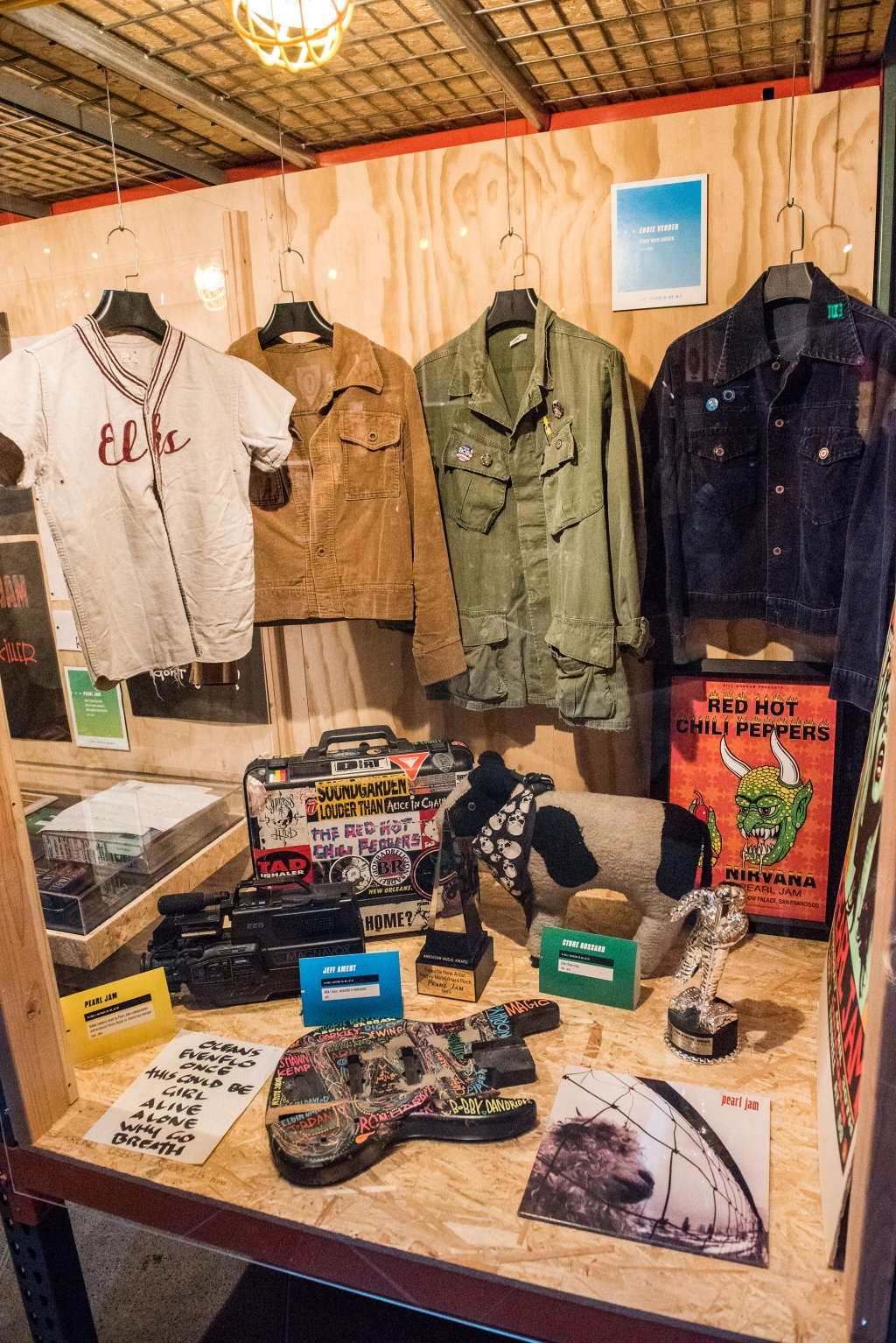 """Items from the 1993Vs. era. They include a series of Vedder's stage-worn jackets, a camera used by the band's videographer Kevin Shuss to record live footage, a bass destroyed by Ament, Stone Gossard's cow stage prop and awards including their American Music Award for """"Favorite New Artist: Heavy Metal/Hard Rock."""""""