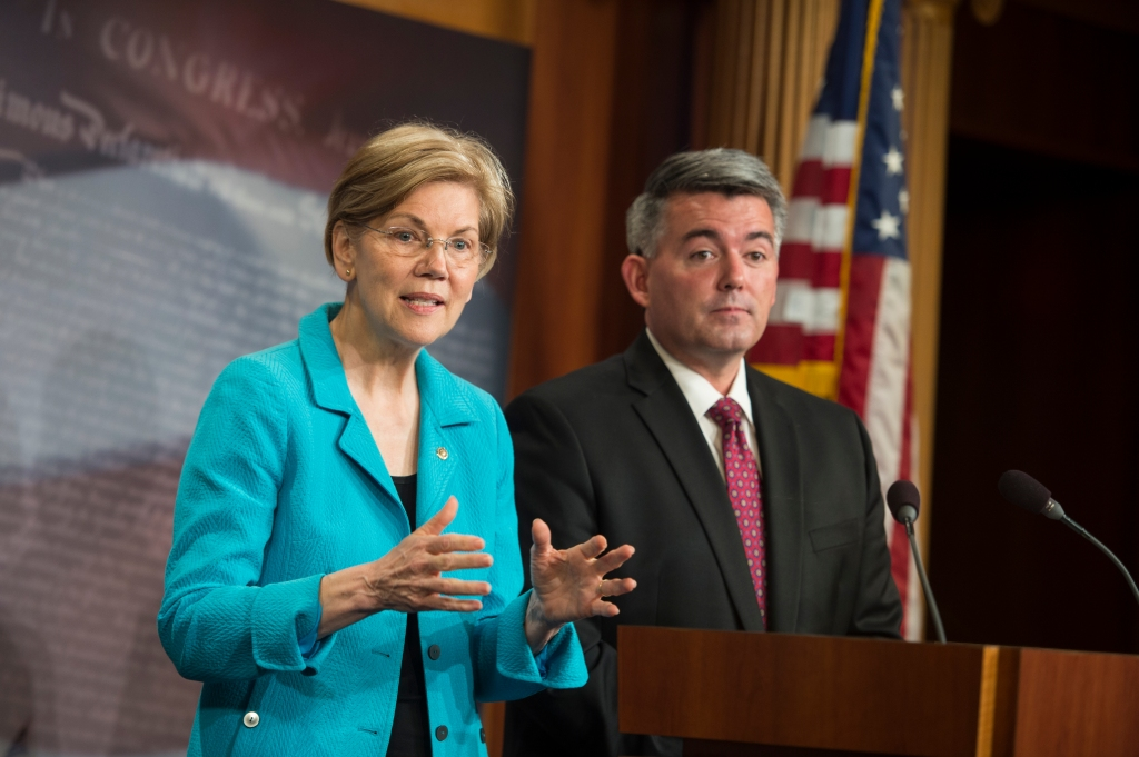 UNITED STATES - June 7: Sen. Elizabeth Warren, D-Mass., and Sen. Cory Gardner, R-Colo., hold a press conference in the Senate Radio and TV Gallery to discuss bipartisan action they are taking to put marijuana legislation into the hands of state lawmakers Thursday June 7, 2018. (Photo By Sarah Silbiger/CQ Roll Call) (CQ Roll Call via AP Images)