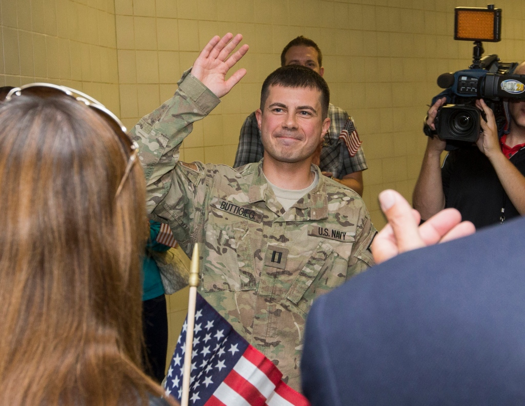 South Bend Mayor Pete Buttigieg is welcomed Thursday, Sept. 25, 2014, at South Bend International Airport after returning from a seven-month tour of duty with the U.S. Navy in Afghanistan. (AP Photo/South Bend Tribune, Greg Swiercz)