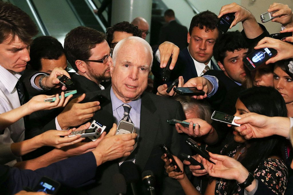 McCain talks to reporters after leaving a closed door meeting about Syria at the U.S. Capitol on September 4, 2013 in Washington, D.C.
