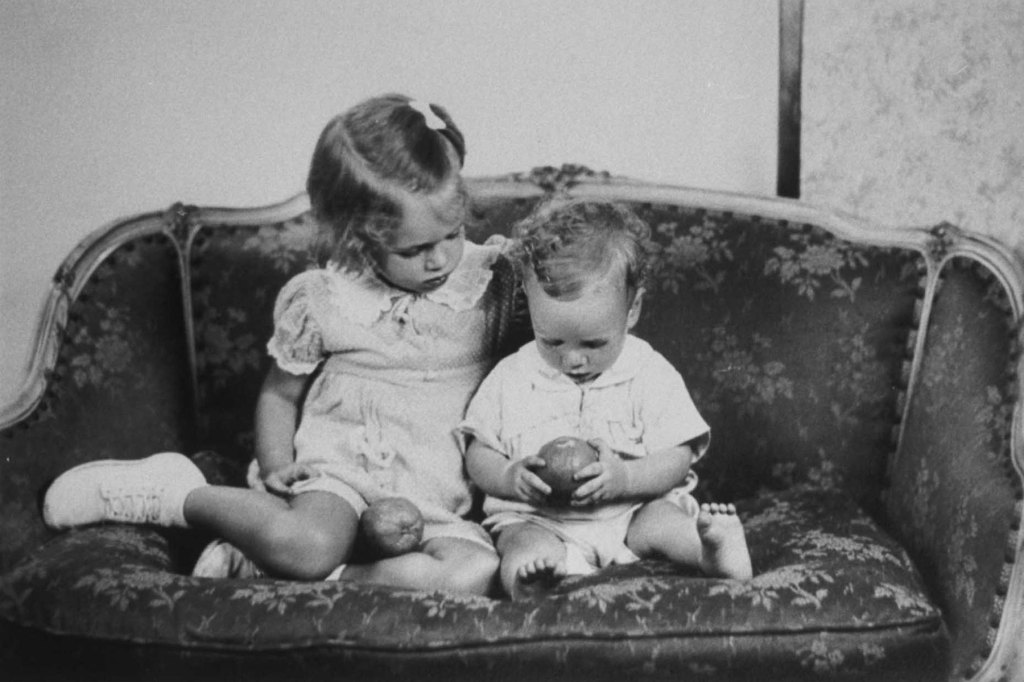The future Senator John McCain as a toddler, sitting on the sofa with his sister Sandy in reproduction of a family photo, circa 1938.