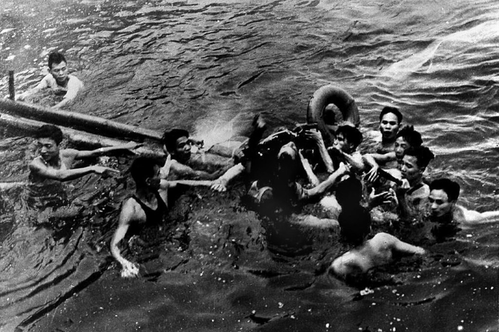 Photo taken October 26, 1967 that shows US Navy Airforce Major John McCain (center) being rescued from Hanoi's Truc Bach lake by several Hanoi residents after his Navy warplane was downed by Northern Vietnamese army during the Vietnam War. One of his rescuers said 24 February 2000, McCain was well treated after being pulled from the lake by villagers. McCain said that upon capture he was beaten by an angry mob and bayoneted in the groin.